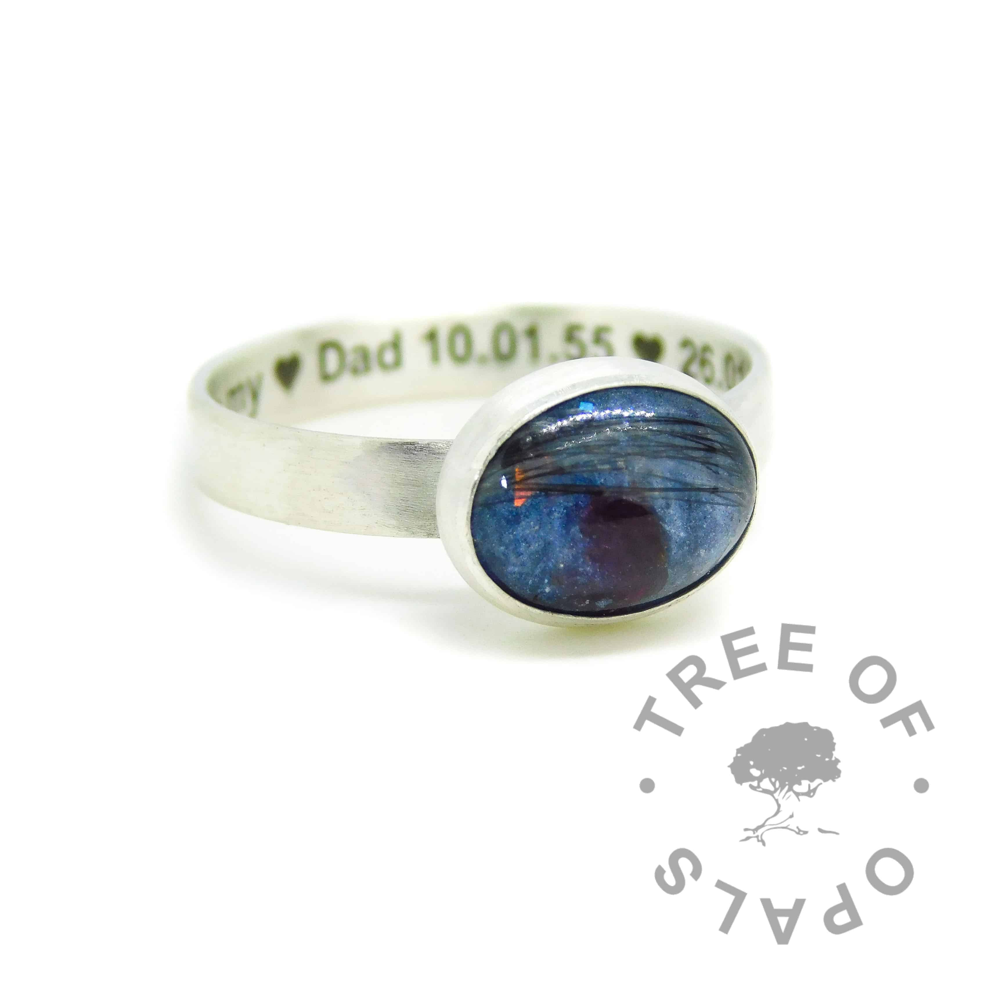 Engraved brushed band lock of hair ring with Aegean blue resin sparkle mix and salt and pepper grey hair, with January birthstone red garnet. Engraved inside in Arial font and hearts. Handmade solid sterling silver memorial ring