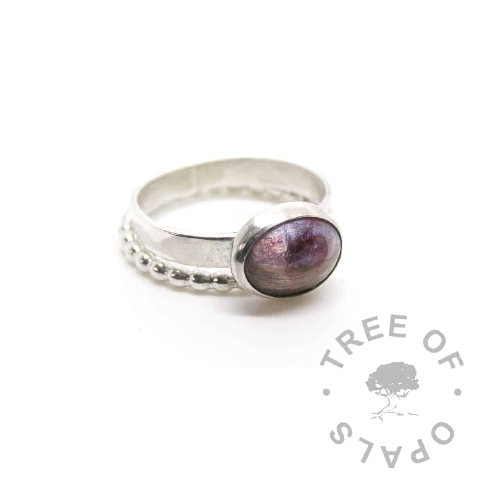 lock of hair ring fairy pink and red garnet January birthstone on a shiny band with a bubble wire ring stacker
