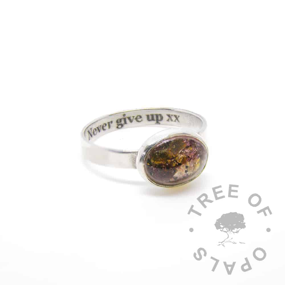 "laser engraved text inside brushed band umbilical cord keepsake ring classic cord (clear resin) and January birthstone red garnet in a 10x8mm cabochon ""stone"" by Tree of Opals"