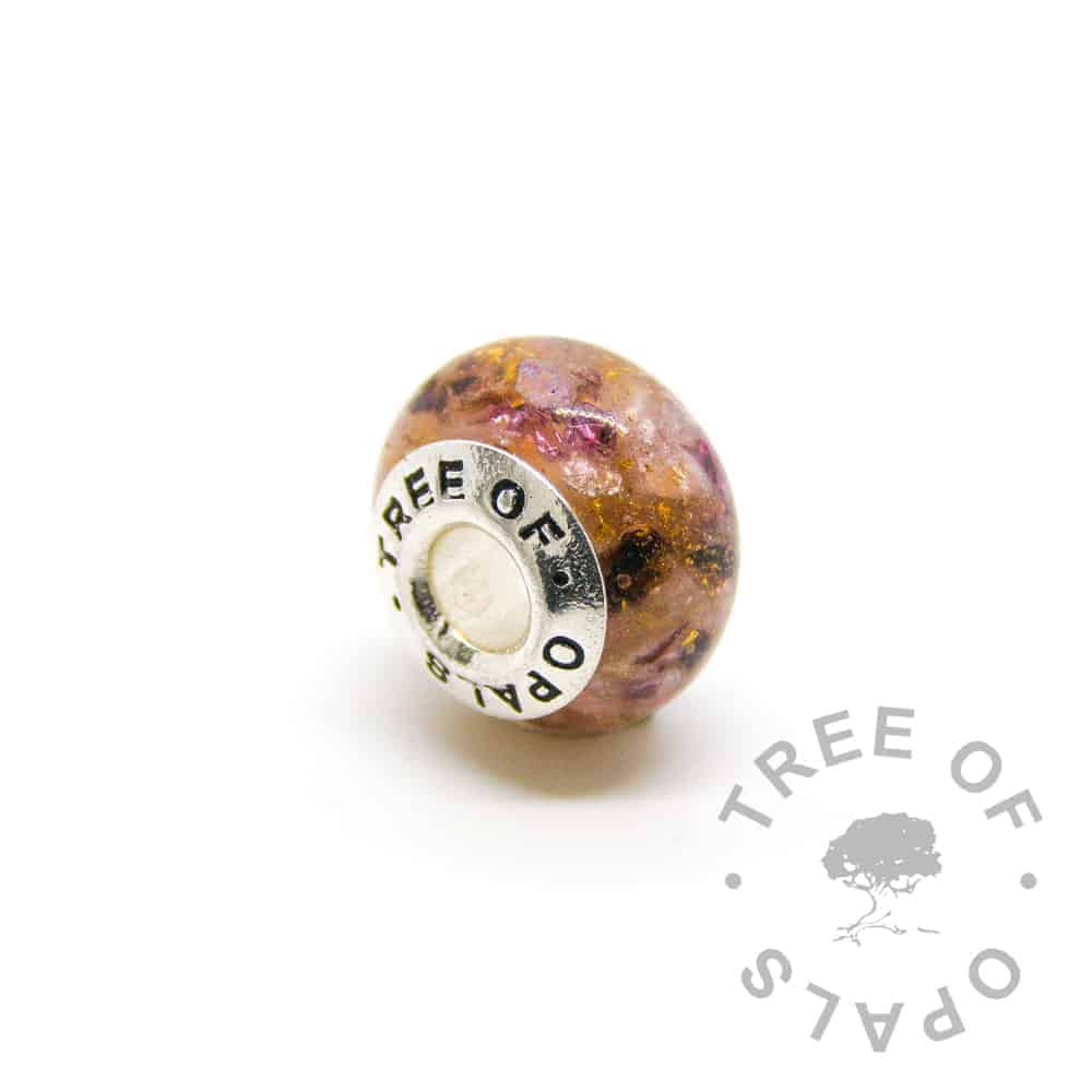 umbilial cord charm red garnet with silver and gold leaf, fairy pink sparkles January birthstone