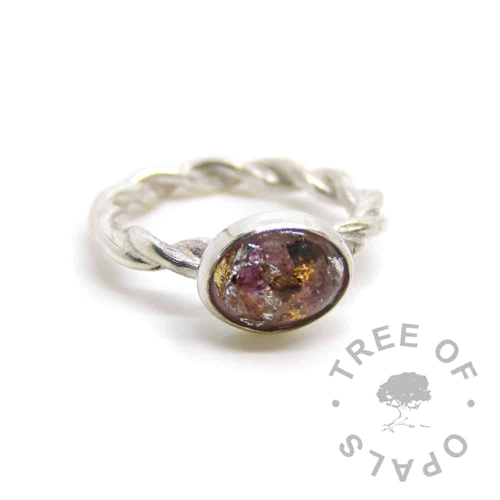 umbilical cord ring with red garnet January birthstone, silver and gold leaf on a twisted band ring