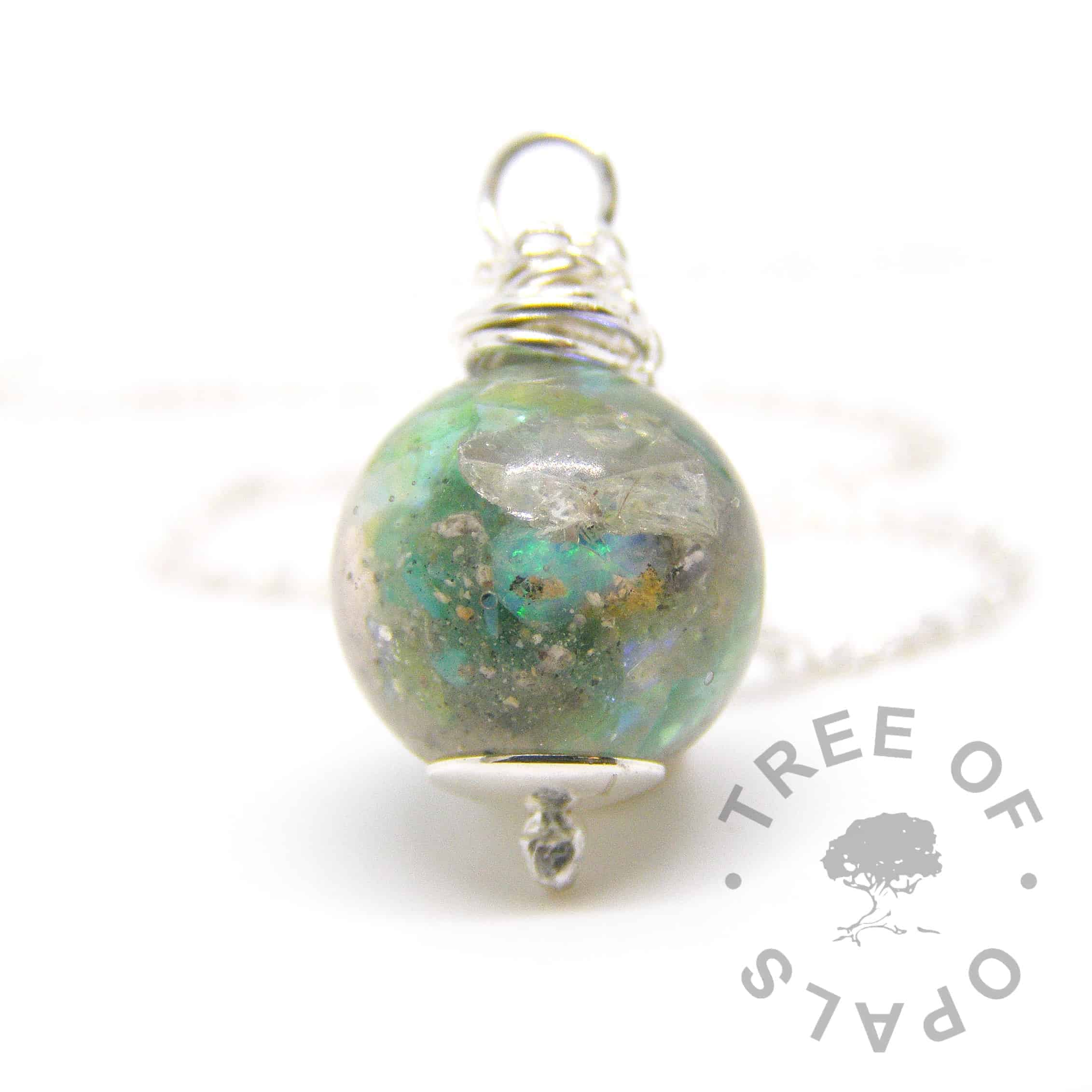 cremation ashes pearl necklace in resin, green opalescent, peridot August birthstone with a solid sterling silver Tree of Opals hand wire wrapped setting, cremation ash pearl for necklaces or charm bracelets