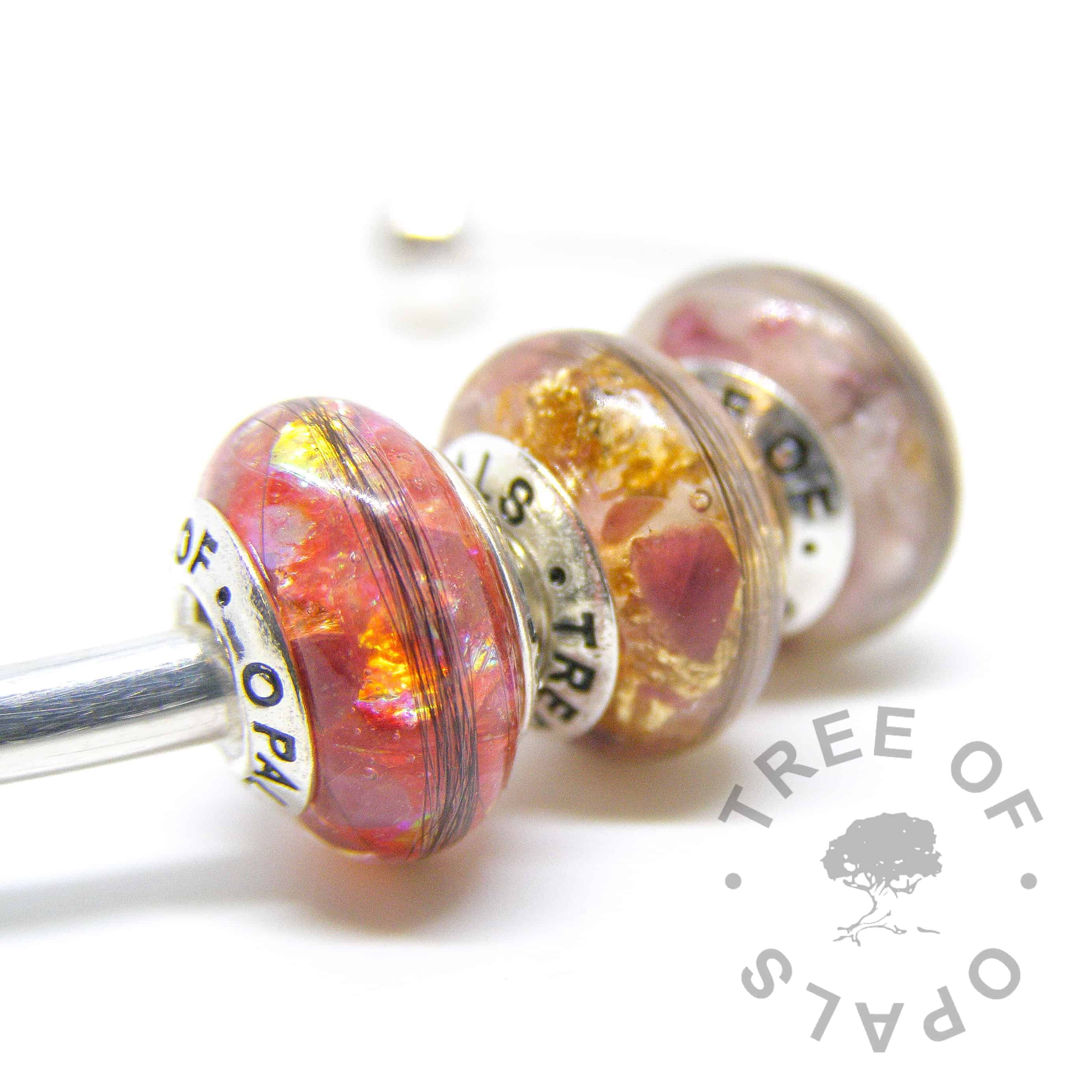 lock of hair charm bead trio in resin, ruby July birthstone, red opalescent flakes and genuine gold leaf with solid sterling silver Tree of Opals branded cores