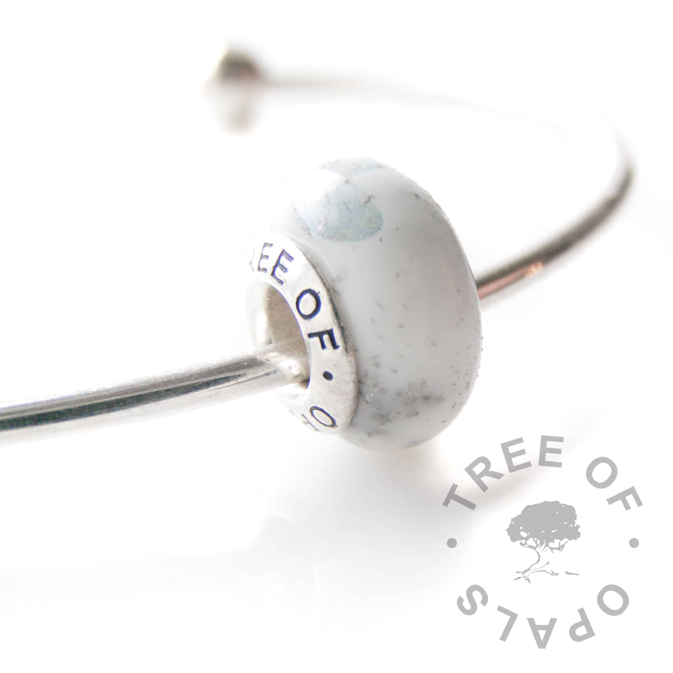 breastmilk charm with platinum leaf and aquamarine, 18 month breastfeeding award and March birthstone.  Tree of Opals solid branded core