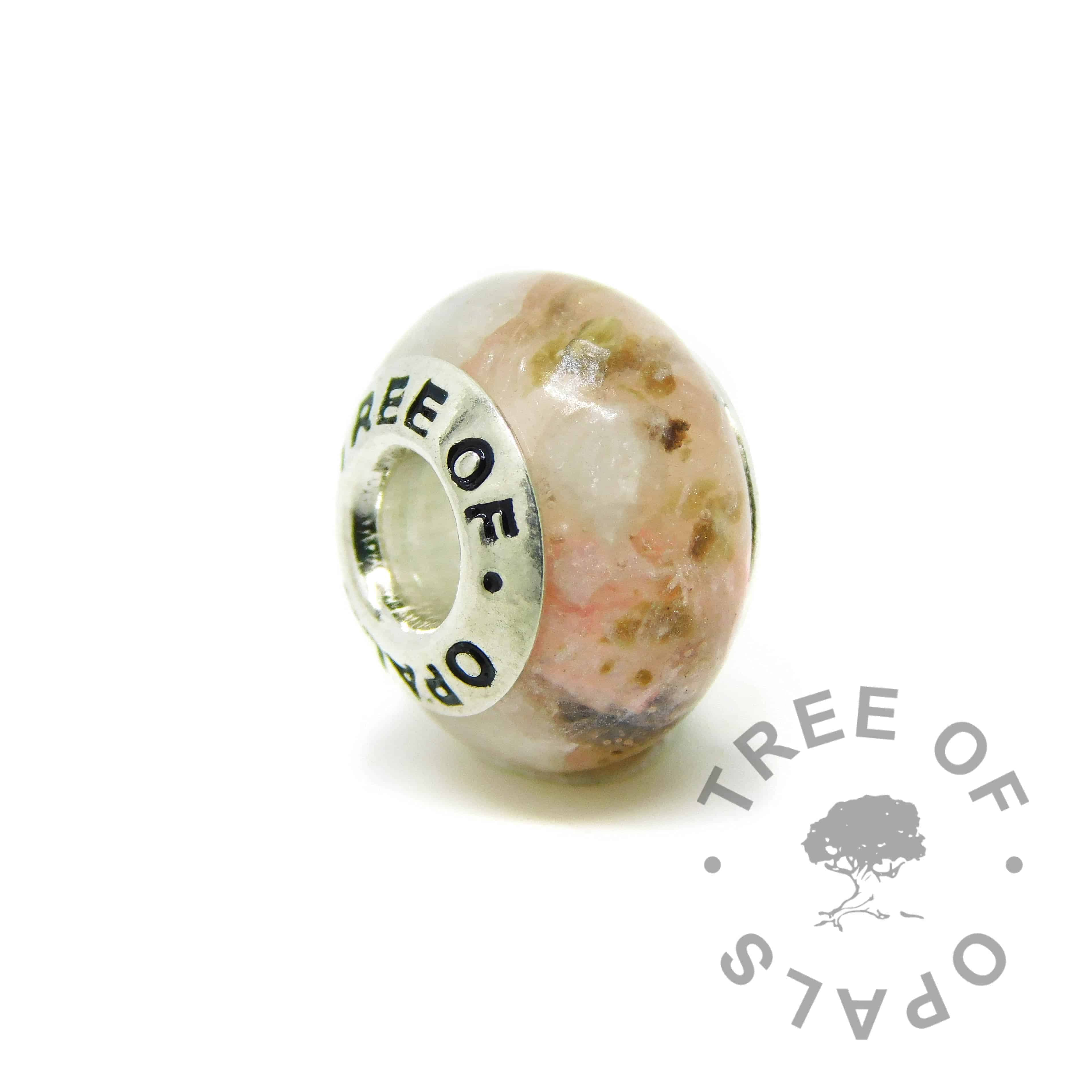 Umbilical cord charm. Placenta umbilical cord with fairy pink resin sparkle mix, March birthstone aquamarine. Set with solid sterling silver Tree of Opals core for Chamilia and Pandora bracelets. Watermarked copyright image by Tree of Opals