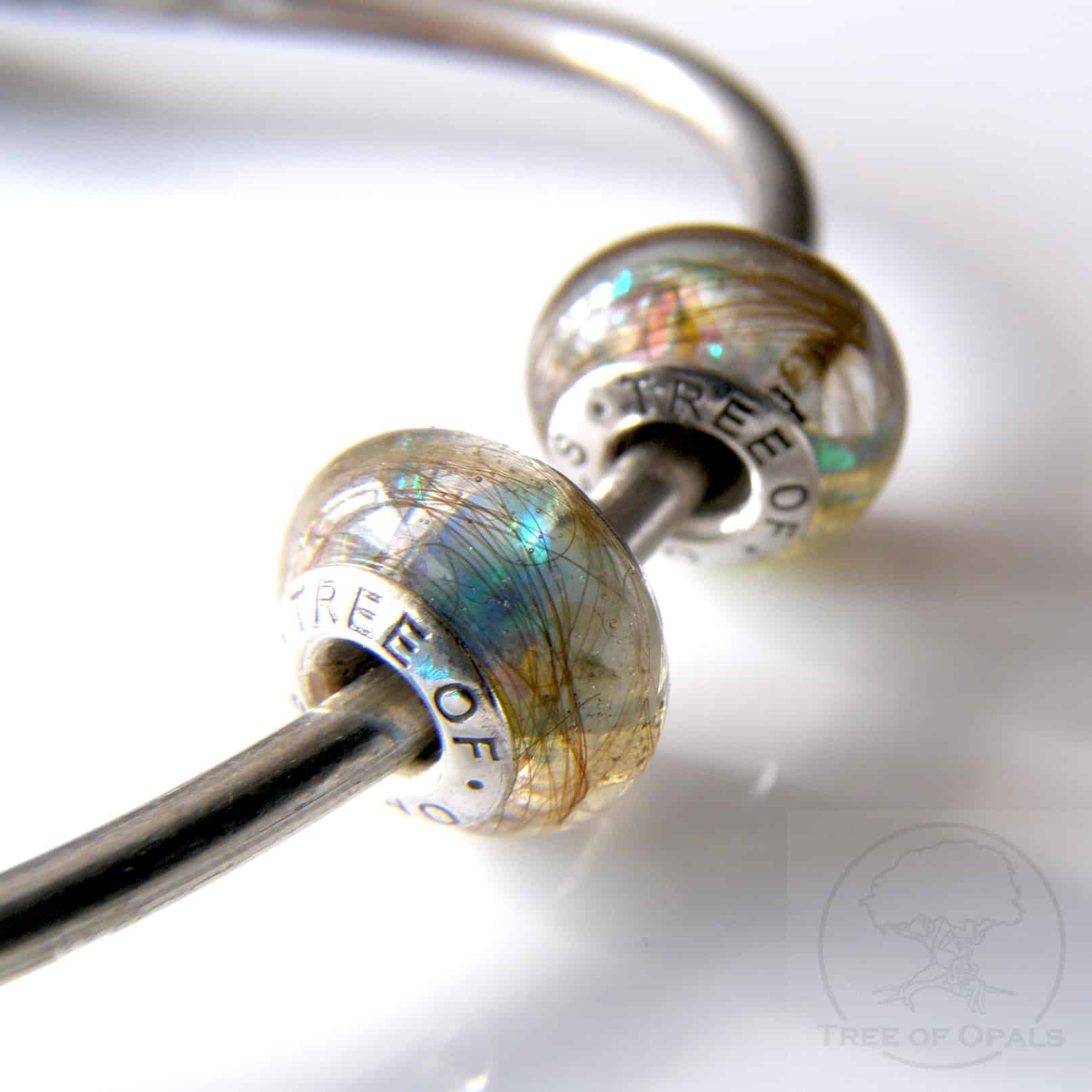 lock of hair charm duo for Pandora bracelets with genuine opal flakes, sapphire and emerald Precious Sparkles