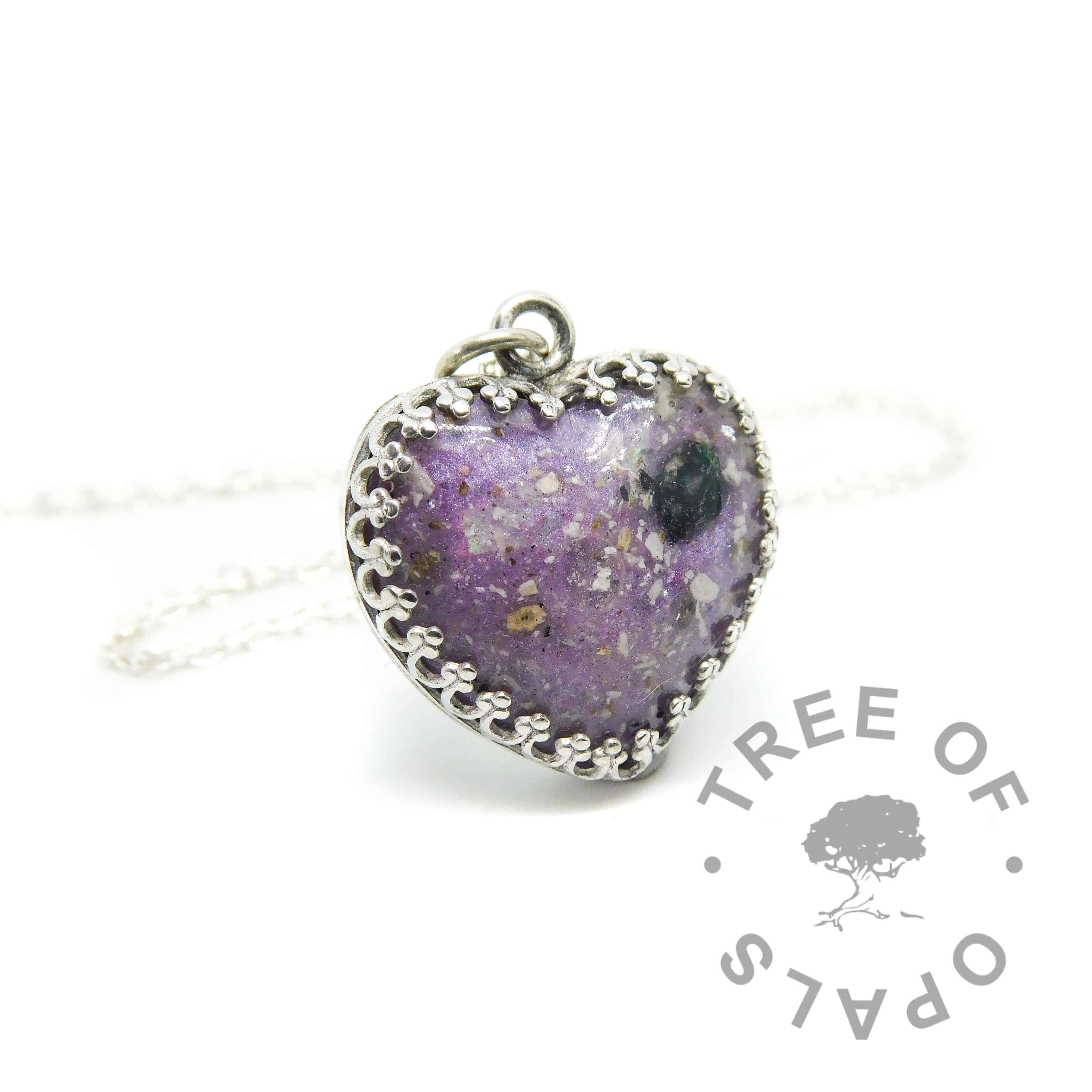 cremation ash heart necklace with orchid purple resin sparkle mix, rough natural emerald May birthstone. 20mm sterling silver crown point heart necklace setting. Watermarked copyright Tree of Opals memorial jewellery image