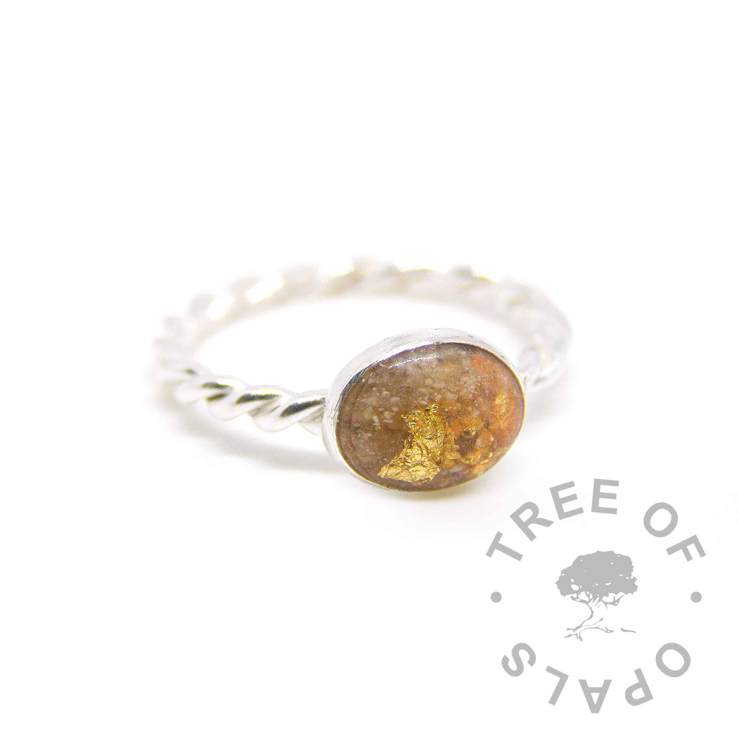 cremation ash ring with yellow topaz December birthstone with tangerine orange shimmer. On a twisted band