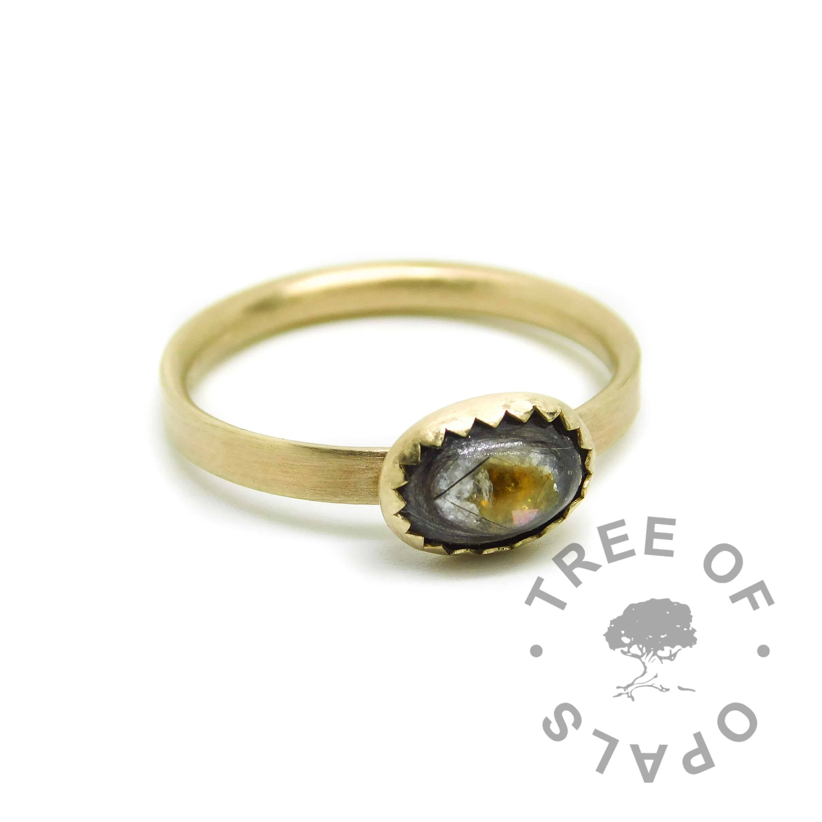 lock of ring and cremation ash gold ring with unicorn white resin sparkle mix, rough natural yellow topaz November birthstone. Handmade brushed 14ct gold ring shank, 8x6mm serrated bezel cup. Watermarked copyright Tree of Opals memorial jewellery image