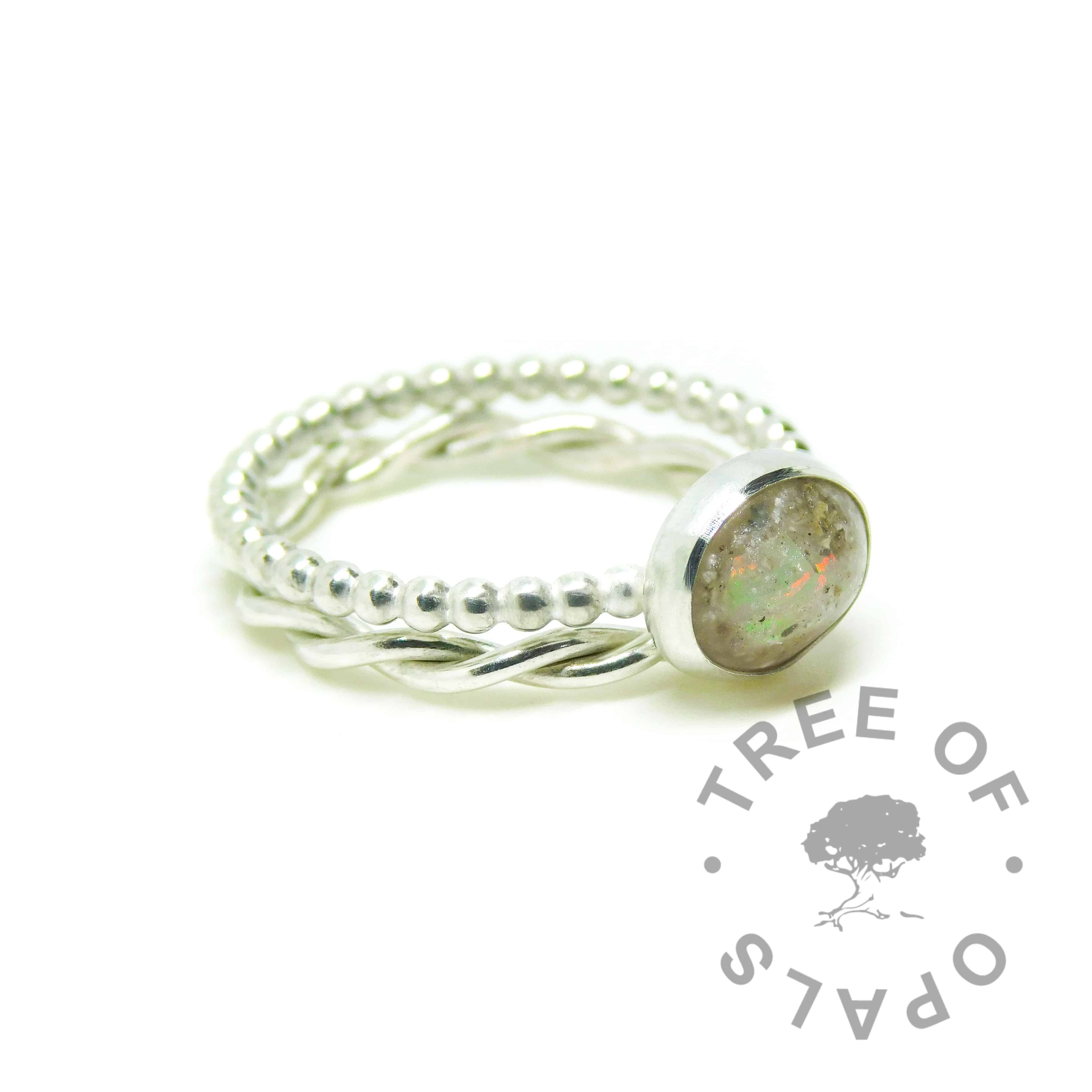 Classic clear resin umbilical cord ring (mockup) with October birthstone opal slices on a bubble wire band. Solid 935 aregentium silver handmade ring. Cremains ring. 10x8mm bezel cup rubbed over the cabochon for security. Shown with a twisted band stacking ring