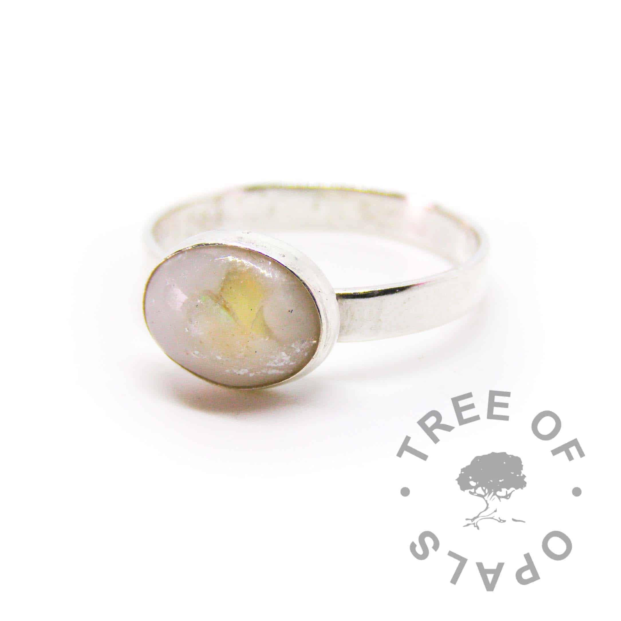 breastmilk ring with genuine opal for October birthstone of 5 year breastfeeding award and unicorn white sparkle mix. Brushed band handmade setting