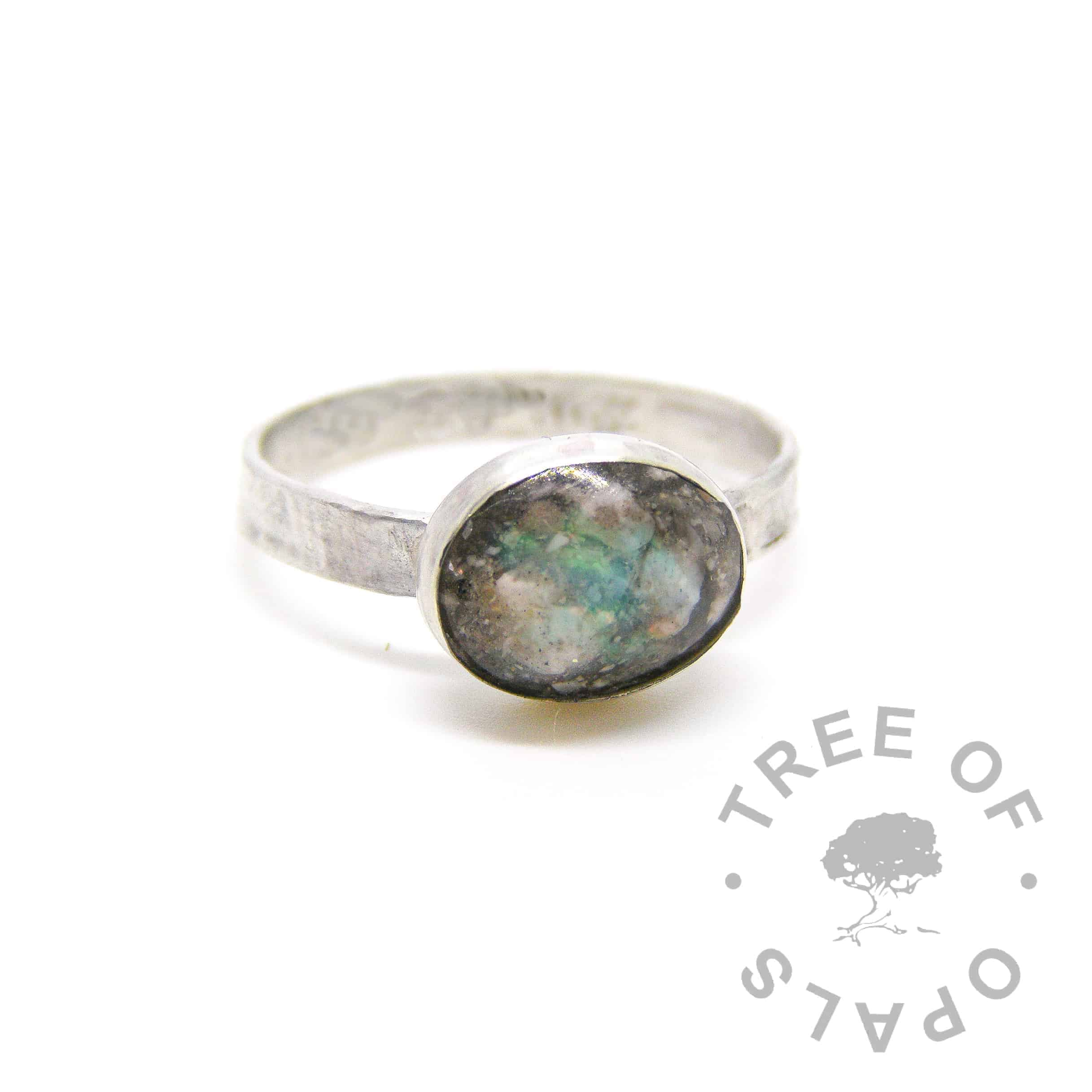 cremation ash ring with real opal October birthstone on textured band