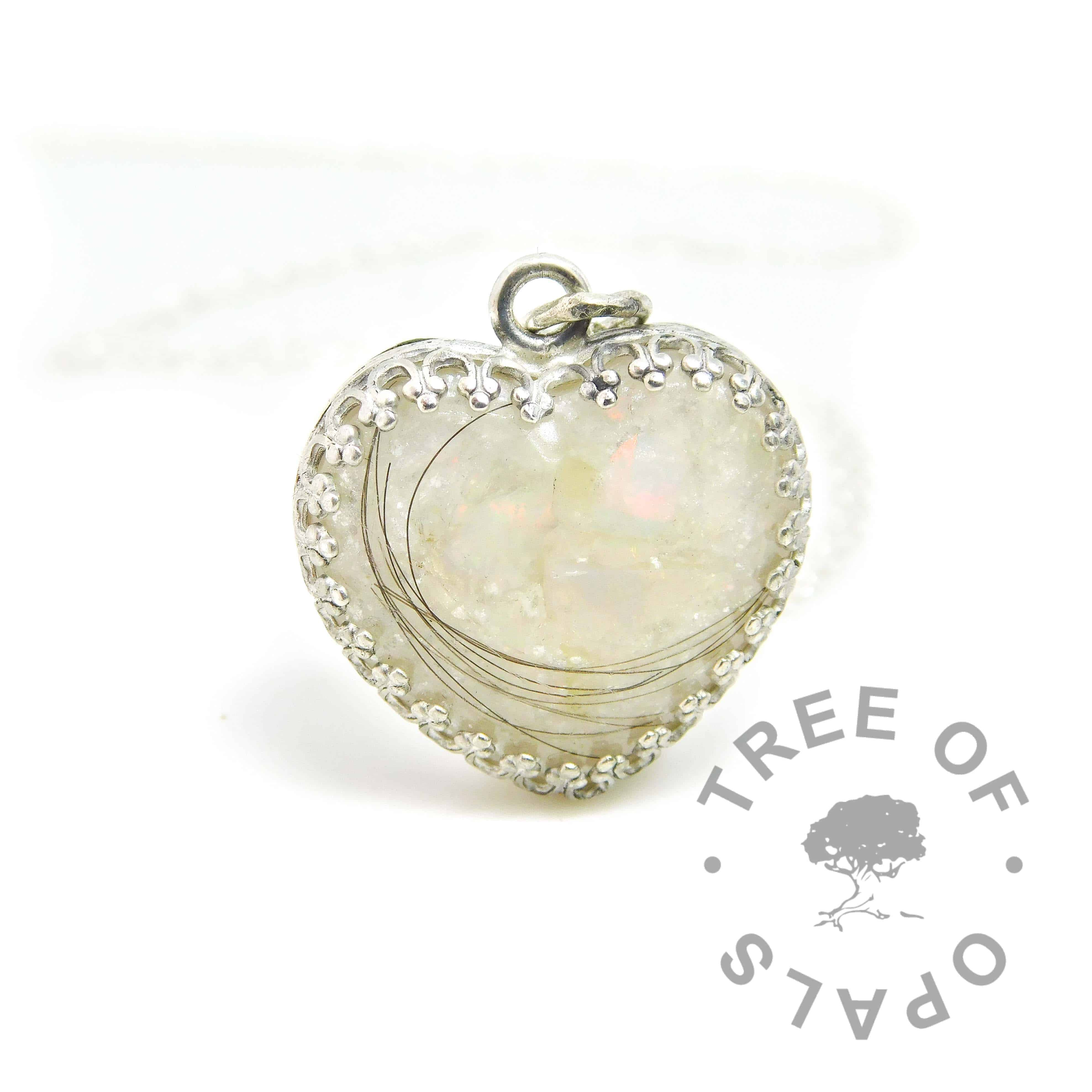 Lock of hair heart necklace with unicorn white resin sparkle mix, rough natural opal slices October birthstone. Solid sterling silver 20mm crown point heart setting (925 stamped on the back). Lightweight classic necklace chain included. Watermarked copyright Tree of Opals memorial jewellery image