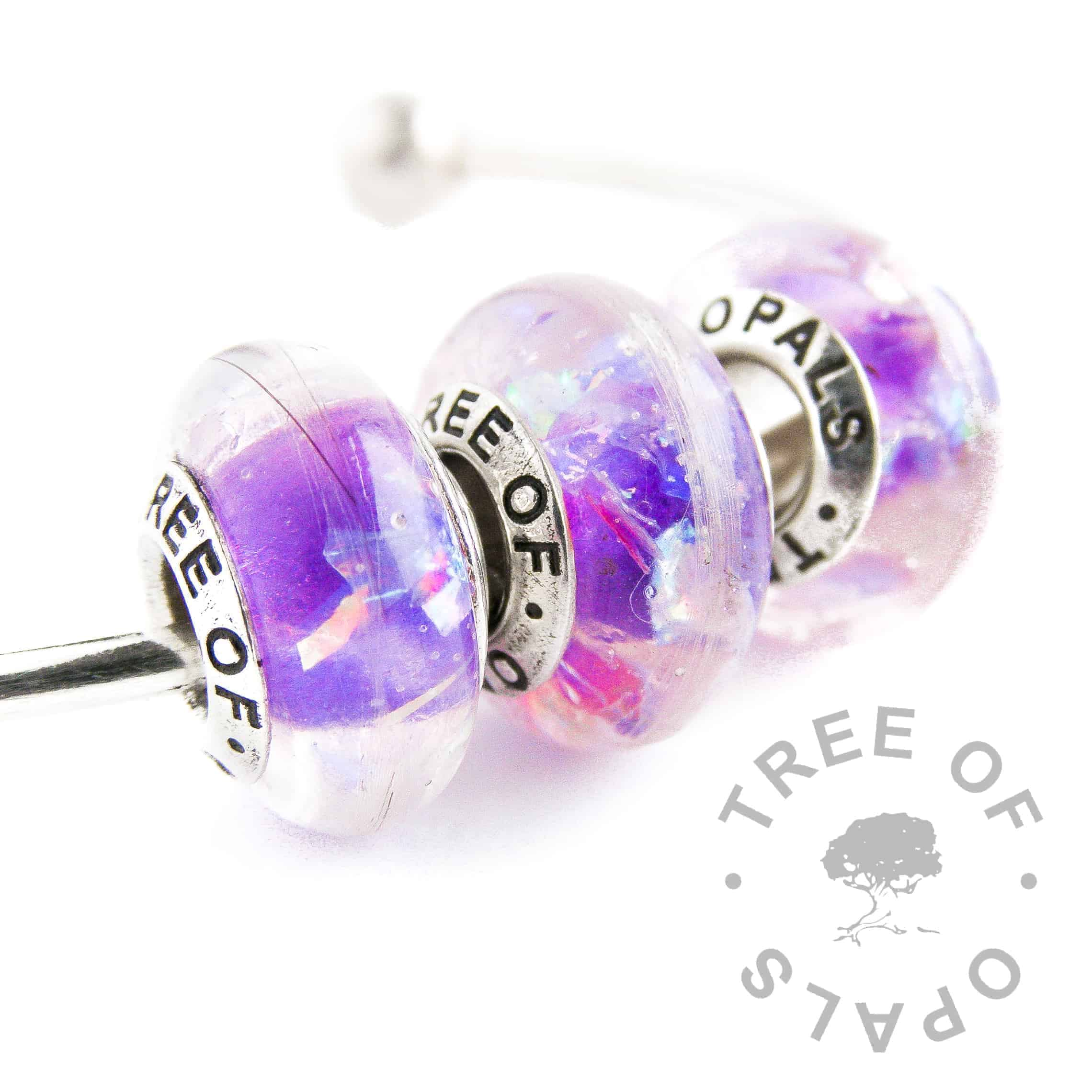hair charm clear resin purple core and opalescent flakes trio
