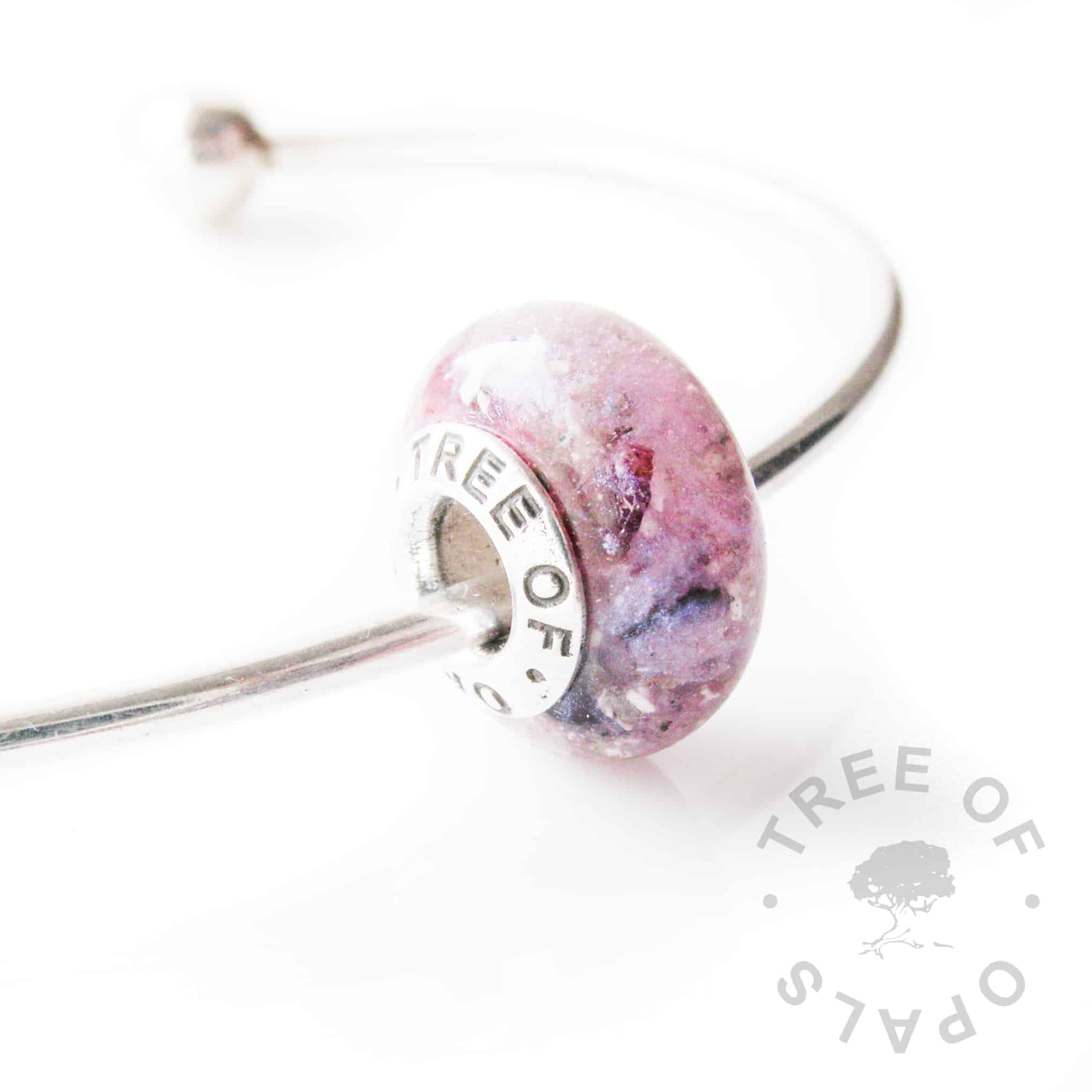 cremation ash charm bead with purple shimmer and red garnet January birthstone