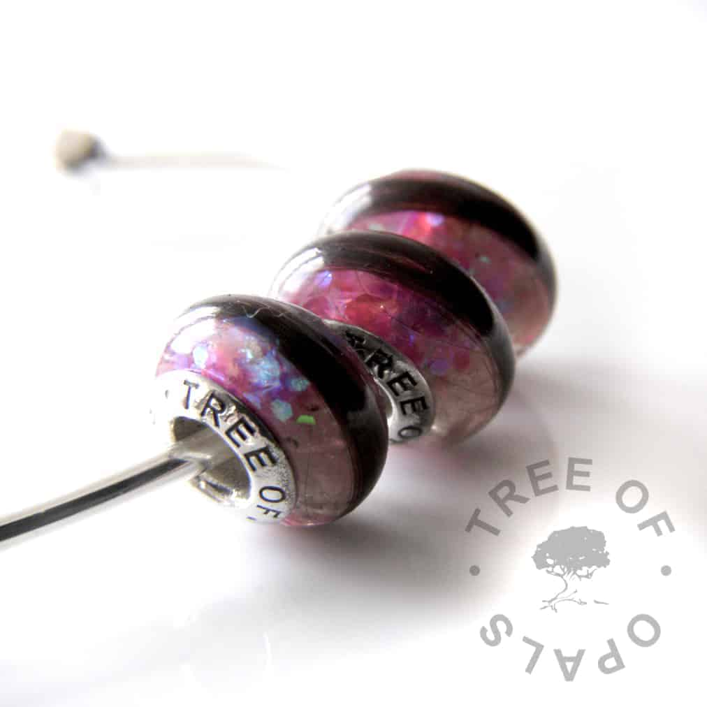 charm bead trio with lock of hair, purple and pink shimmer and opalescent flakes and yellow topaz November birthstone. Solid silver signature Tree of Opals core