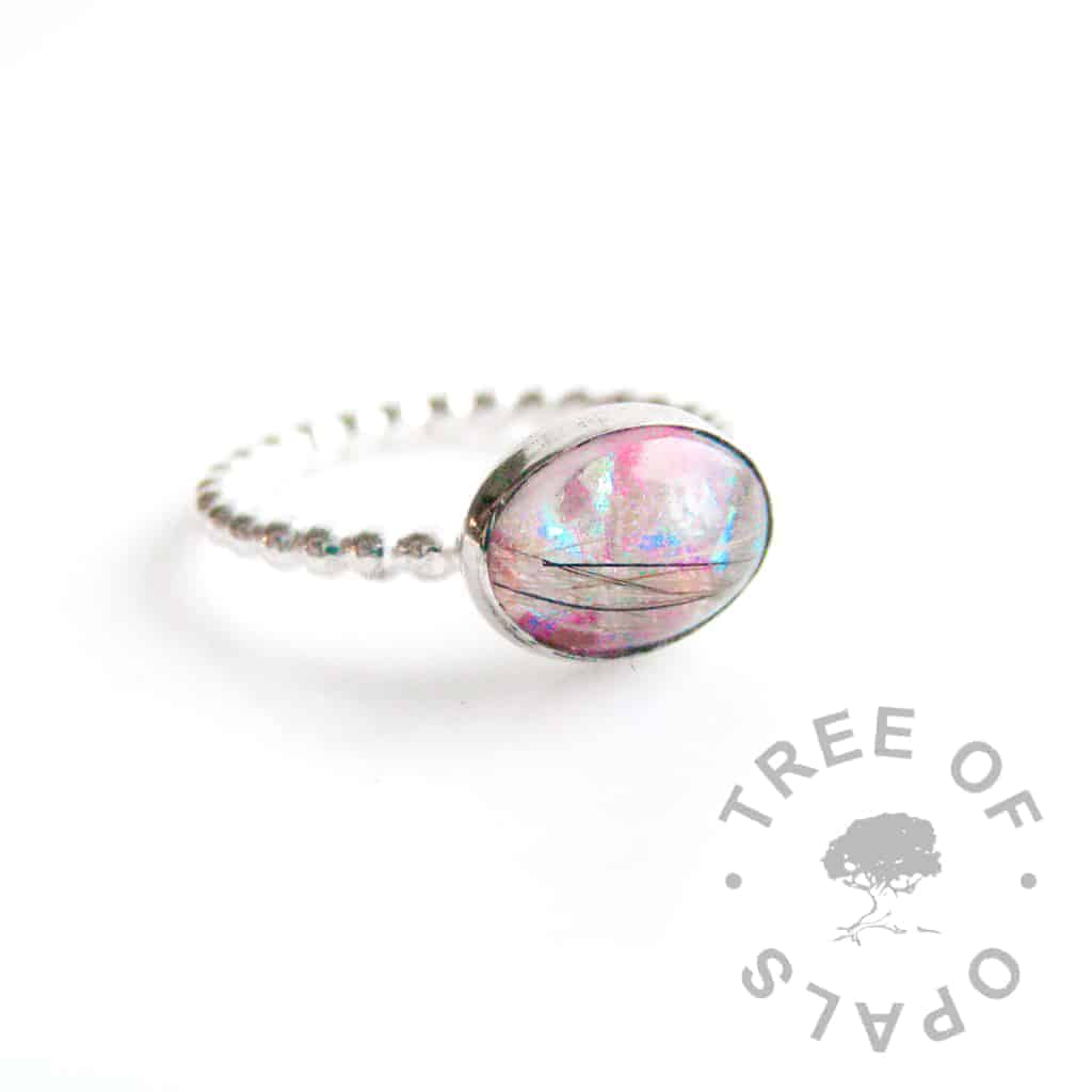 lock of hair ring purple opalescent flakes and fur