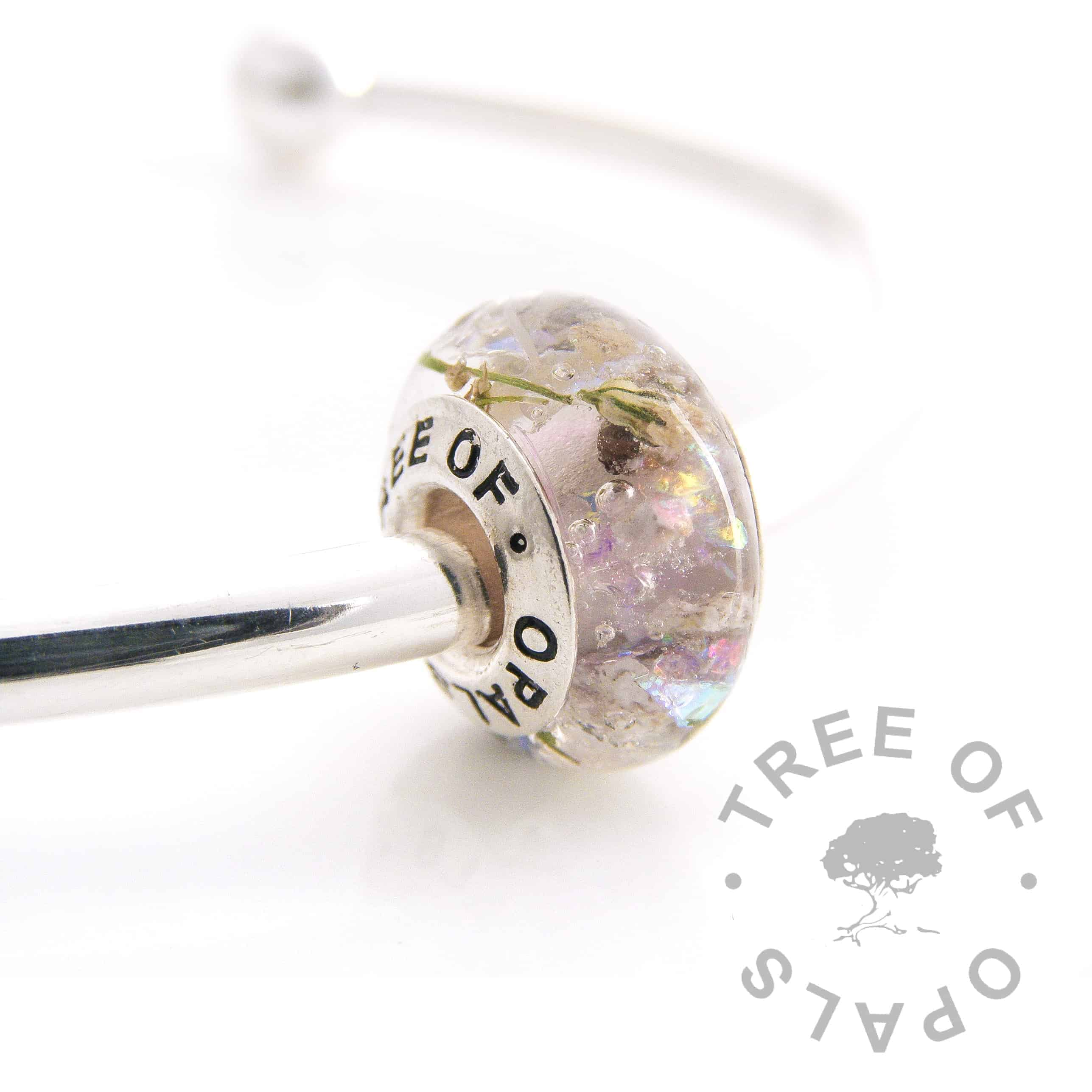 cremation ashes and flower charm trio with purple opalescent flakes, gypsophelia and sapphire September birthstone with cremation ash. Solid sterling silver signature Tree of Opals core
