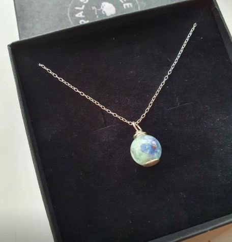 baby memorial necklace pro bono, cremation ashes, angelic aqua resin sparkle mix and a forget me not flower in resin