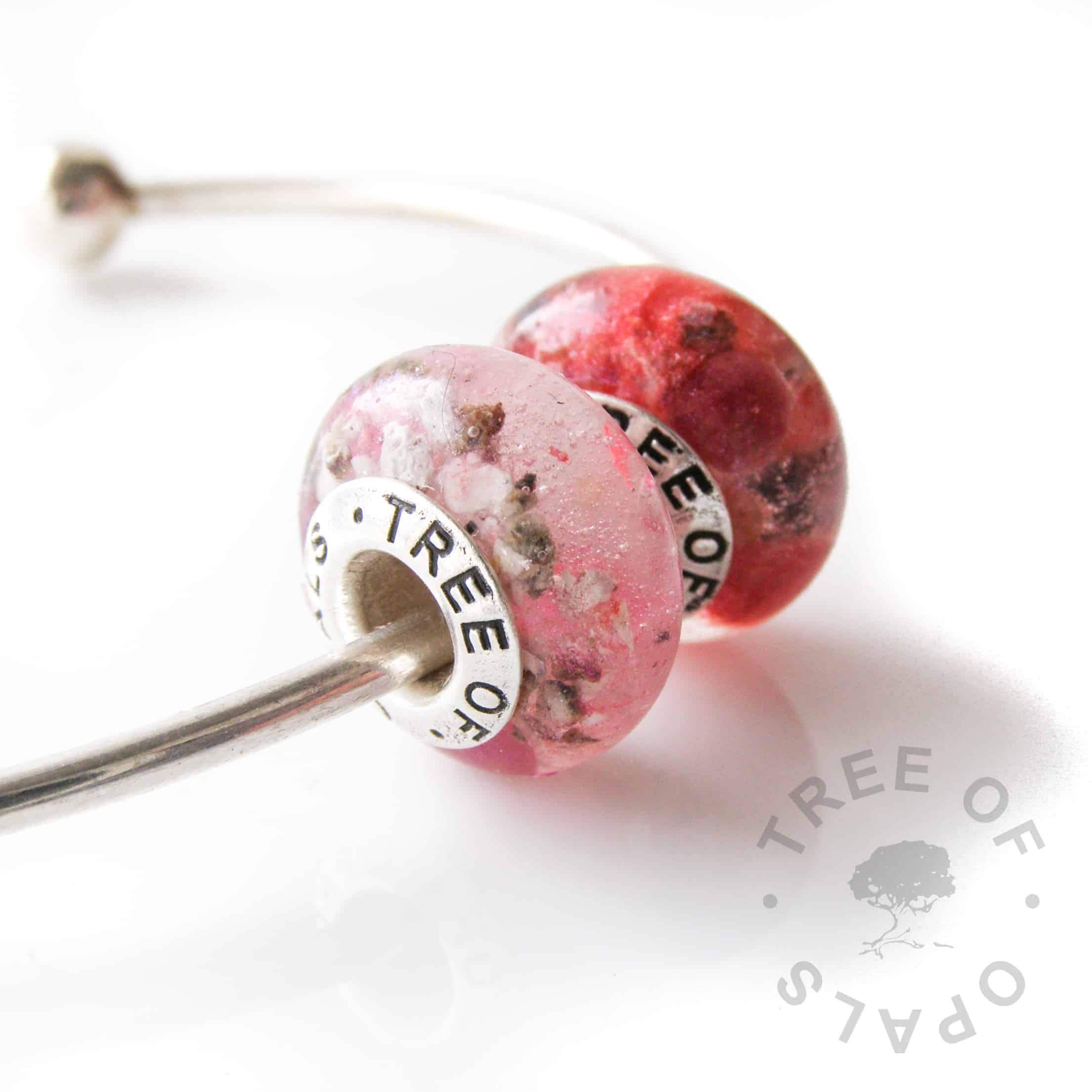 cremation ash charm bead duo with pink and red shimmers - pro bono child loss piece