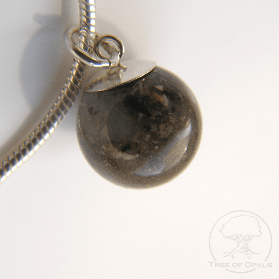Cremation Ash Pearl with solid sterling silver bail. The cremation ash orb is larger and has a large solid silver cone