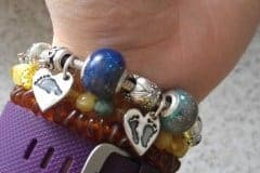 an order made pro bono for a loss mama, two European charm beads with cremation ash and the babies' initials