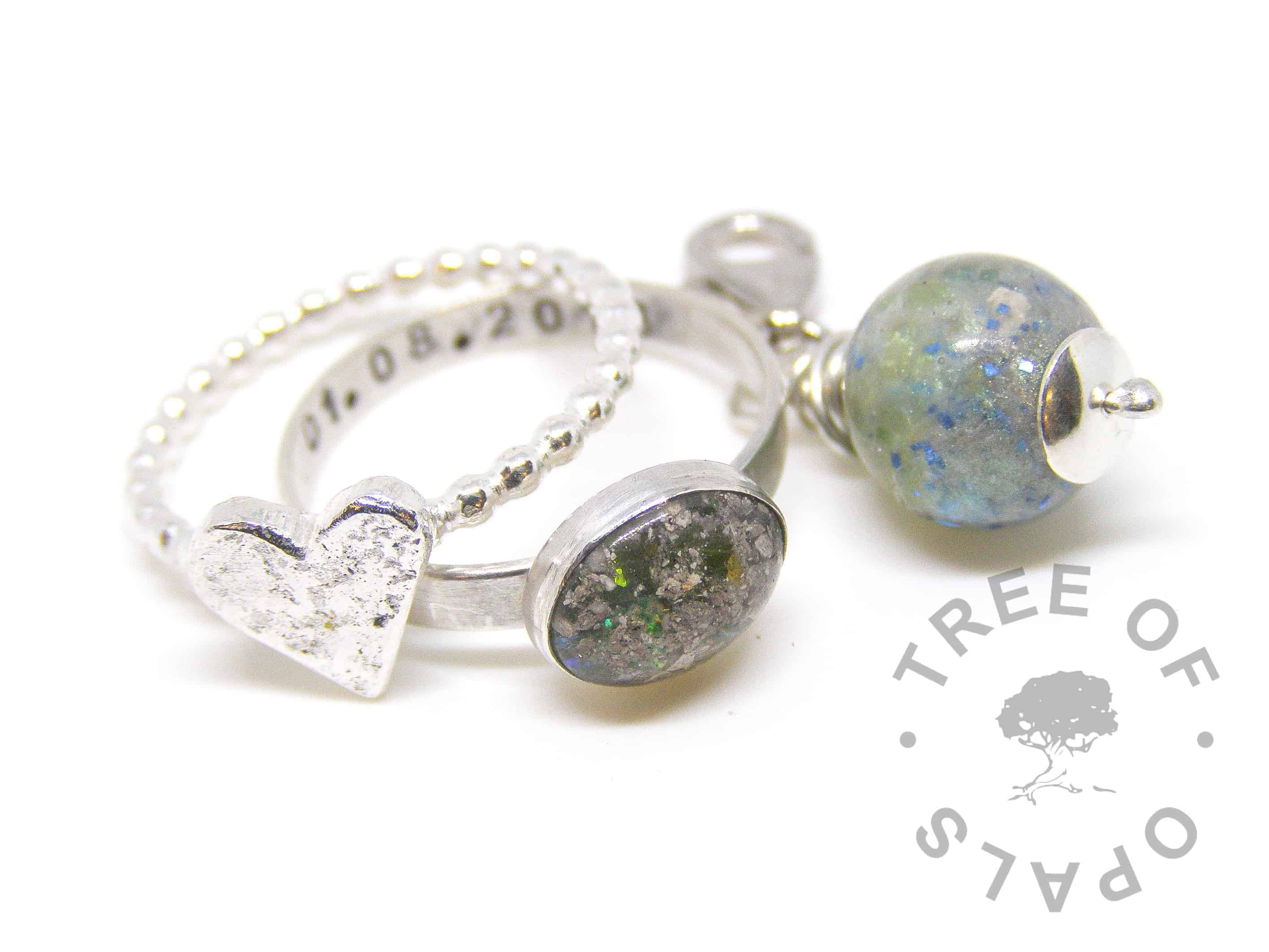 peridot cremation ash family order, lock of hair pearl and stacking ring with peridot August birthstone and cobalt blue glitter. Pro Bono free of charge baby loss ring and mystery piece pearl plus heart accent bubble wire stacking ring