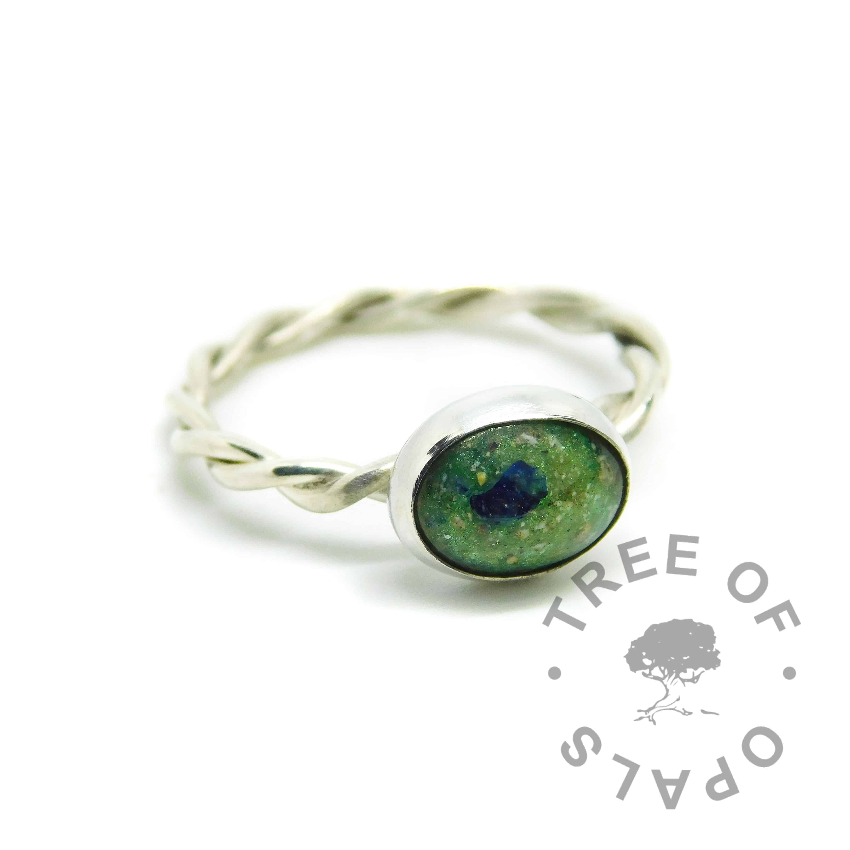 Mystery piece, cremation ash ring with basilisk green resin sparkle mix, with rough natural sapphire September birthstone. Handmade twisted band EcoSilver ring shank, 10x8mm bezel cup. Watermarked copyright Tree of Opals memorial jewellery image