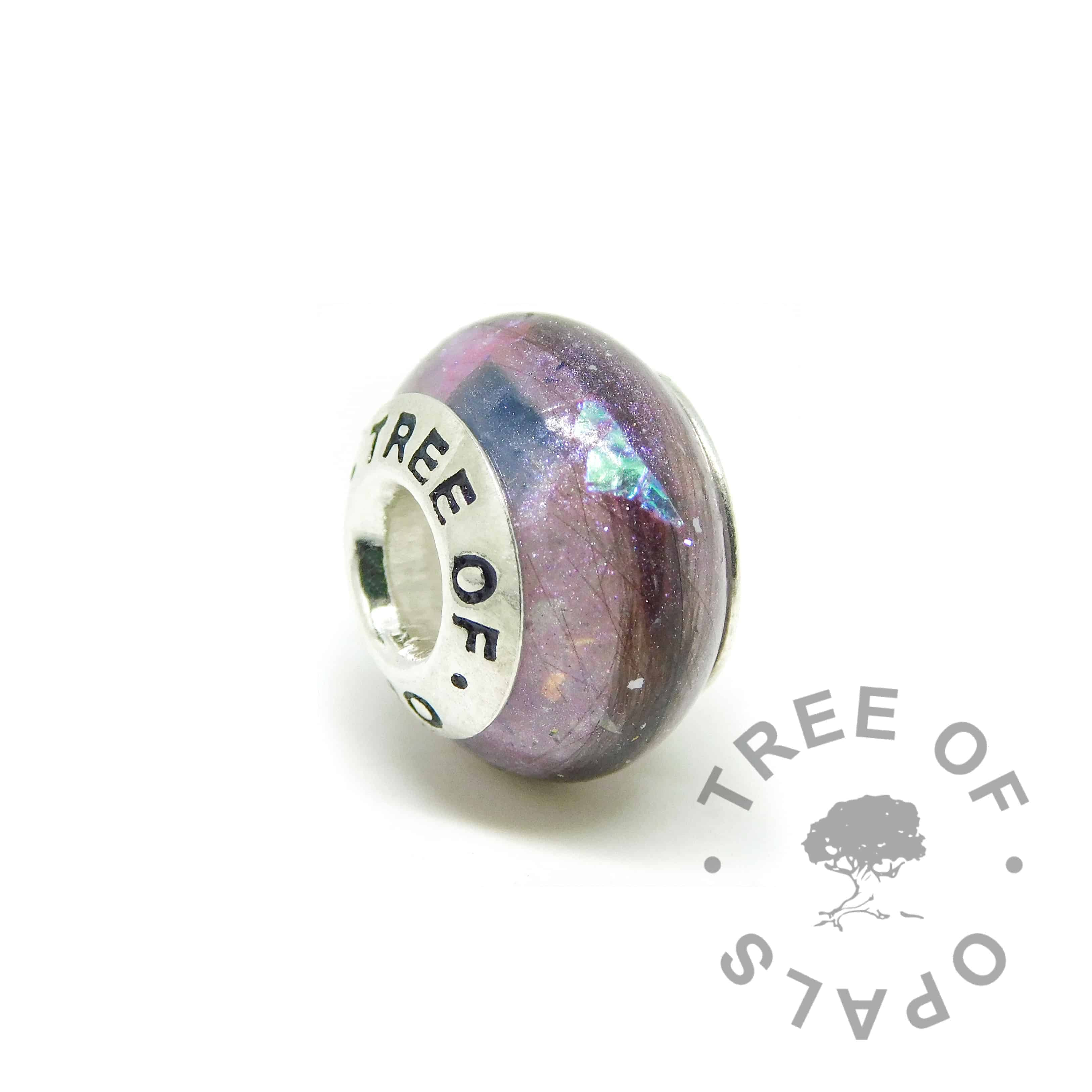 September birthstone sapphire and orchid purple lock of hair memorial charm bead with a solid 925 sterling silver Tree of Opals core. Pressed core for security (not glued on). First curl bead hair charm for Pandora bracelets and necklaces