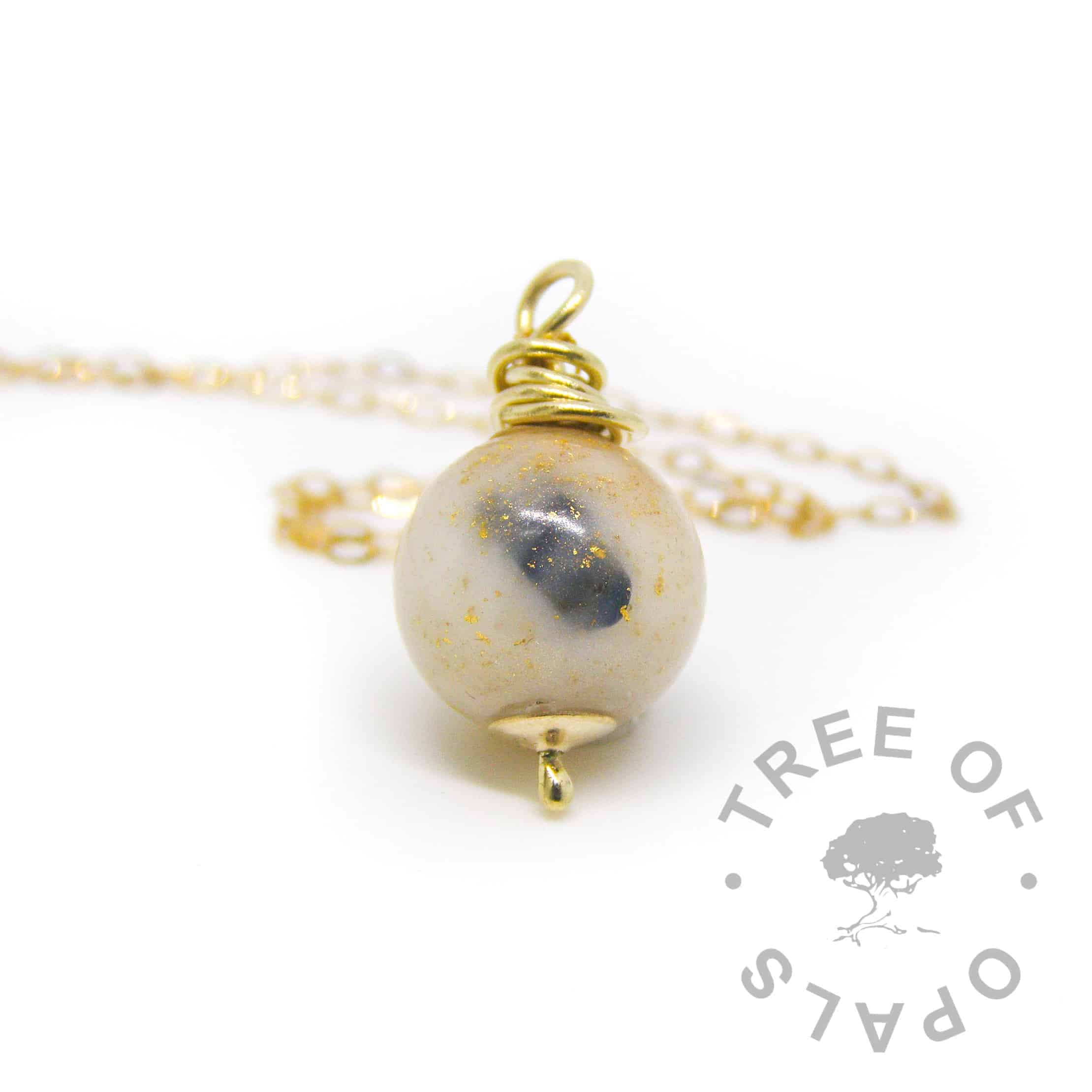 solid gold breastmilk pearl necklace with sapphire September birthstone, genuine gold leaf to represent one year breastfeeding award golden boobies, set with solid 9ct gold hand wire wrapped pearl necklace