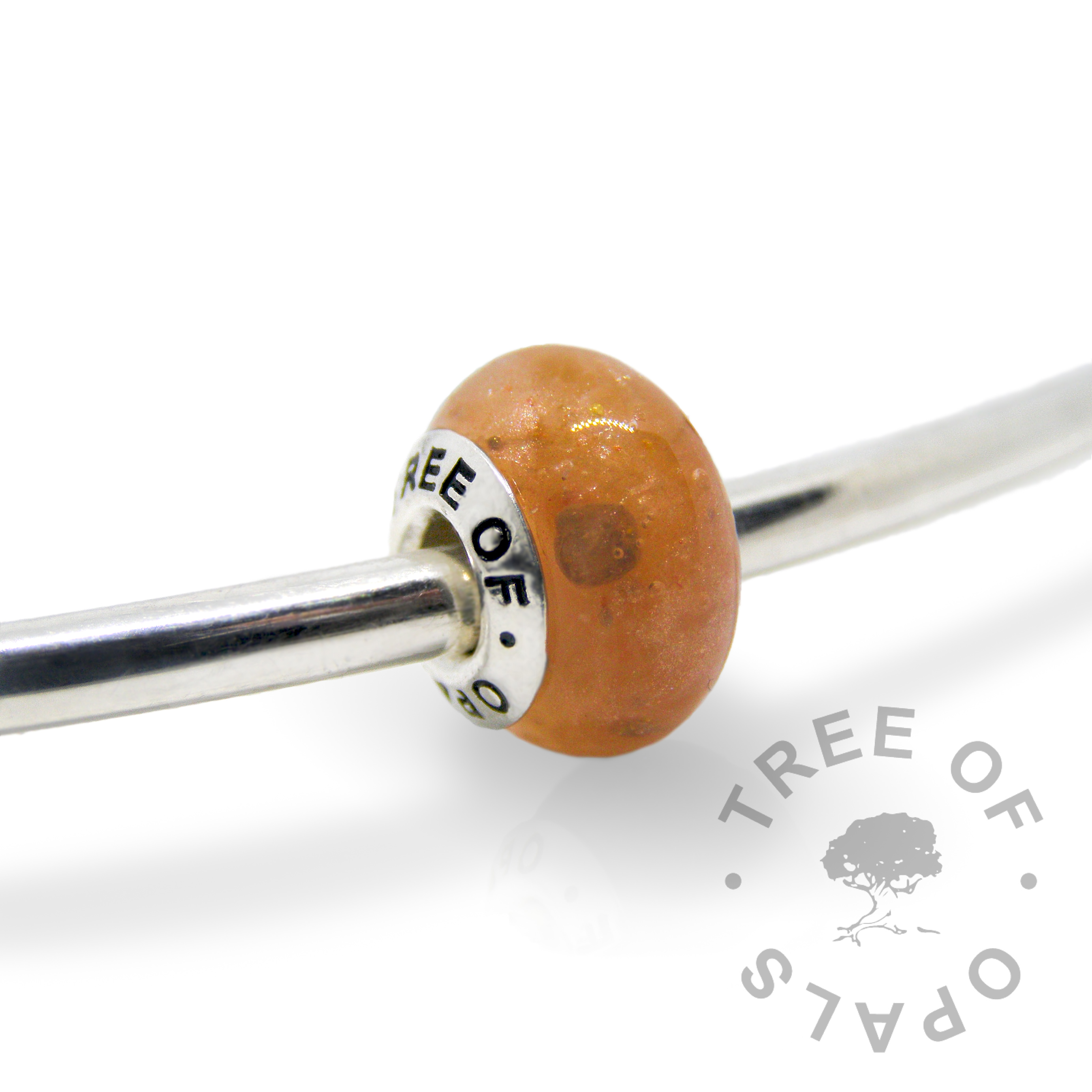 tangerine orange cremation ash charm with solid sterling silver Tree of Opals core