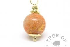 gold cremation ash pearl with yellow topaz December birthstone with tangerine orange shimmer