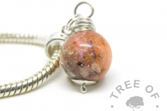 cremation ash pearl with tangerine orange sparkles and opal on a European dangle charm setting for Pandora bracelets