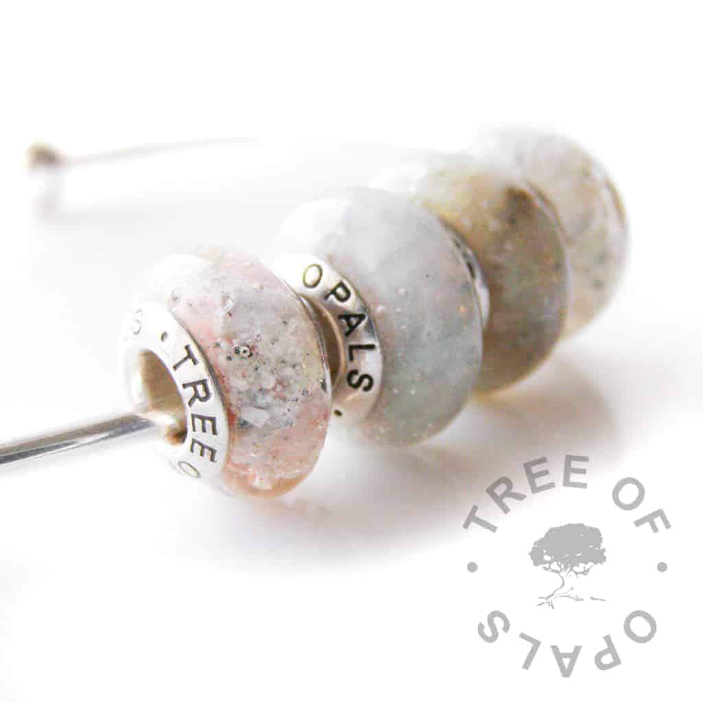 cremation ash charm bead quad with subtle pink core and orange pearlescent and opalescent flakes