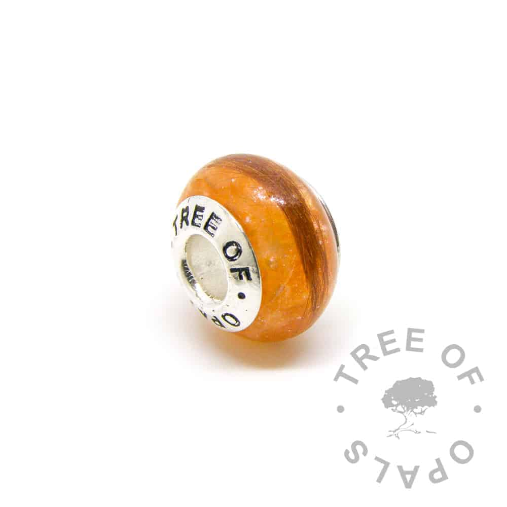 tangerine orange lock of hair charm with solid sterling silver Tree of Opals core. The hair is ginger cat fur