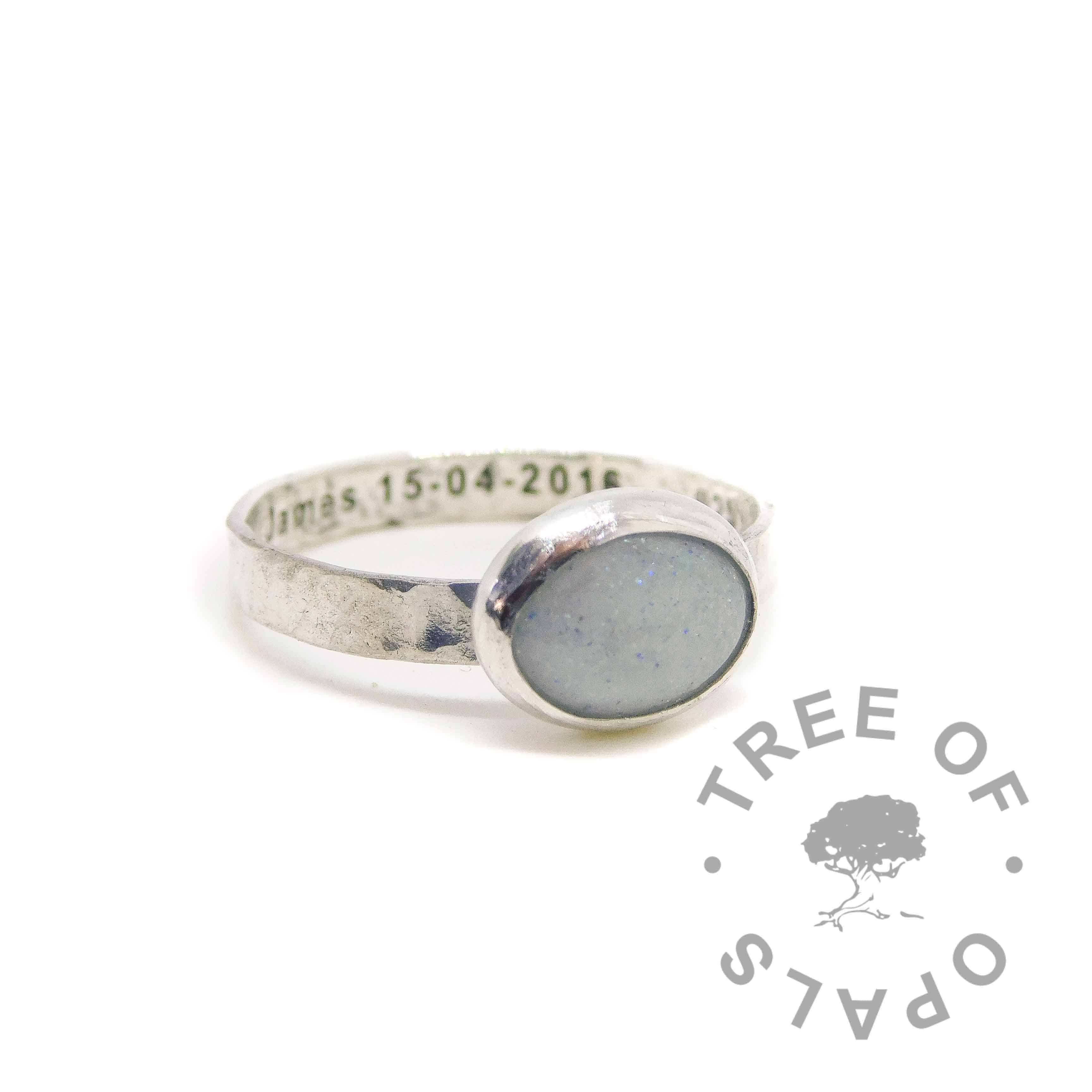 breastmilk ring engraved inside with baby name and date of birth, breastmilk in resin with subtle blue sparkle and diamond powder for April birthstone or two year breastfeeding award diamond boobies
