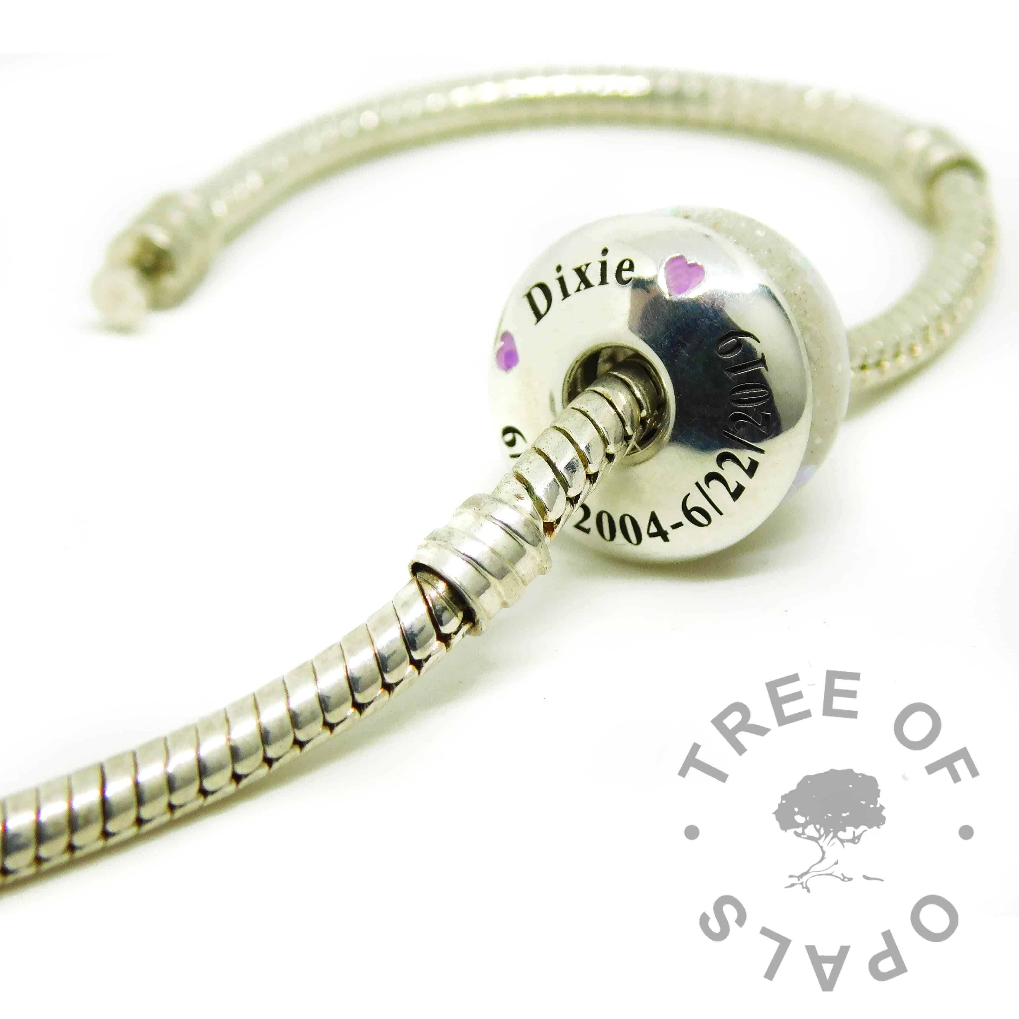 cremation ash charm unicorn resin sparkle mix, and an engraved charm washer on a Pandora bracelet style chain. ashes charms with solid silver cores
