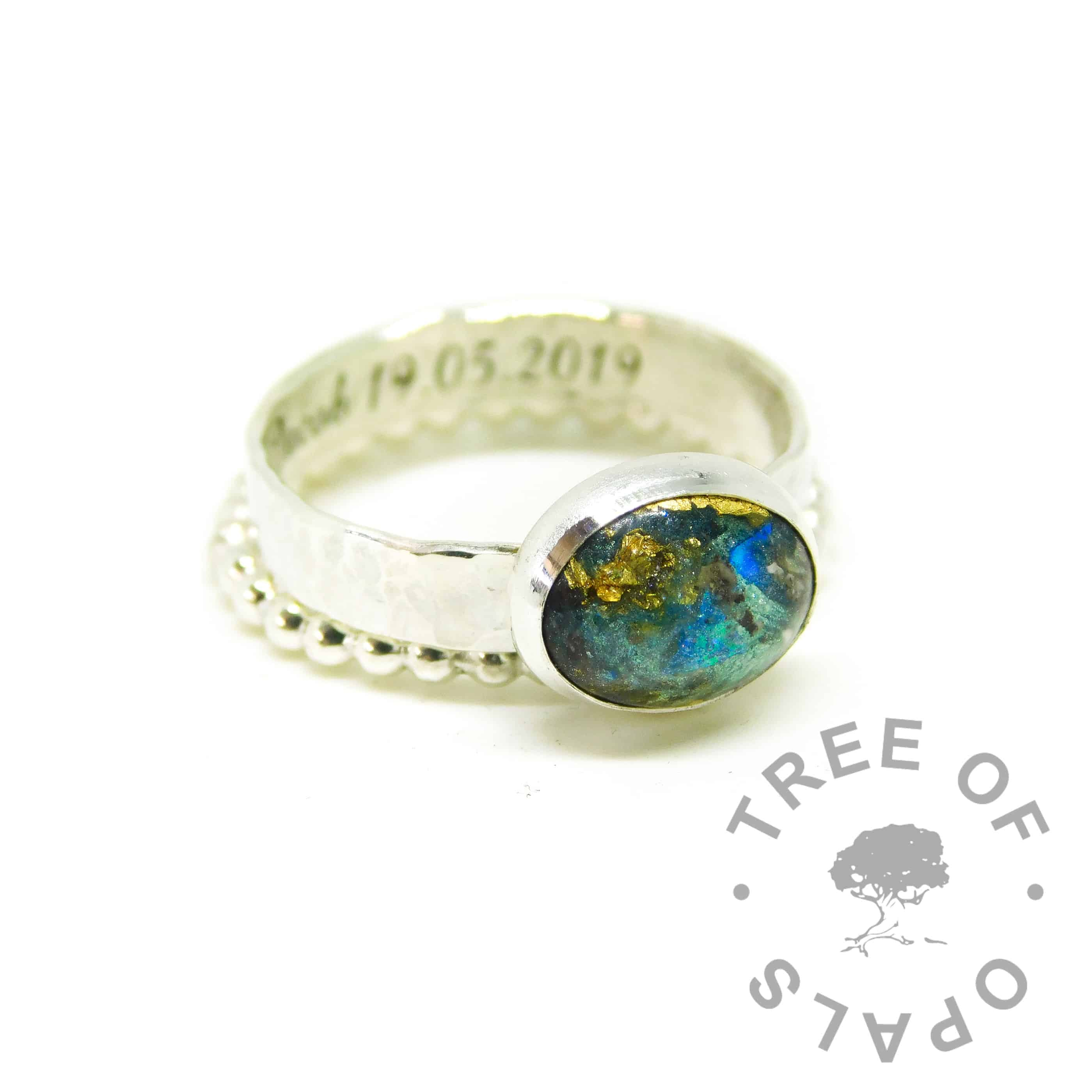 blue green cord ring, umbilical cord with green and blue plus gold leaf. Engraved inside in Amazone BT font. Textured band. Ahown with a bubble wire slim stacking band