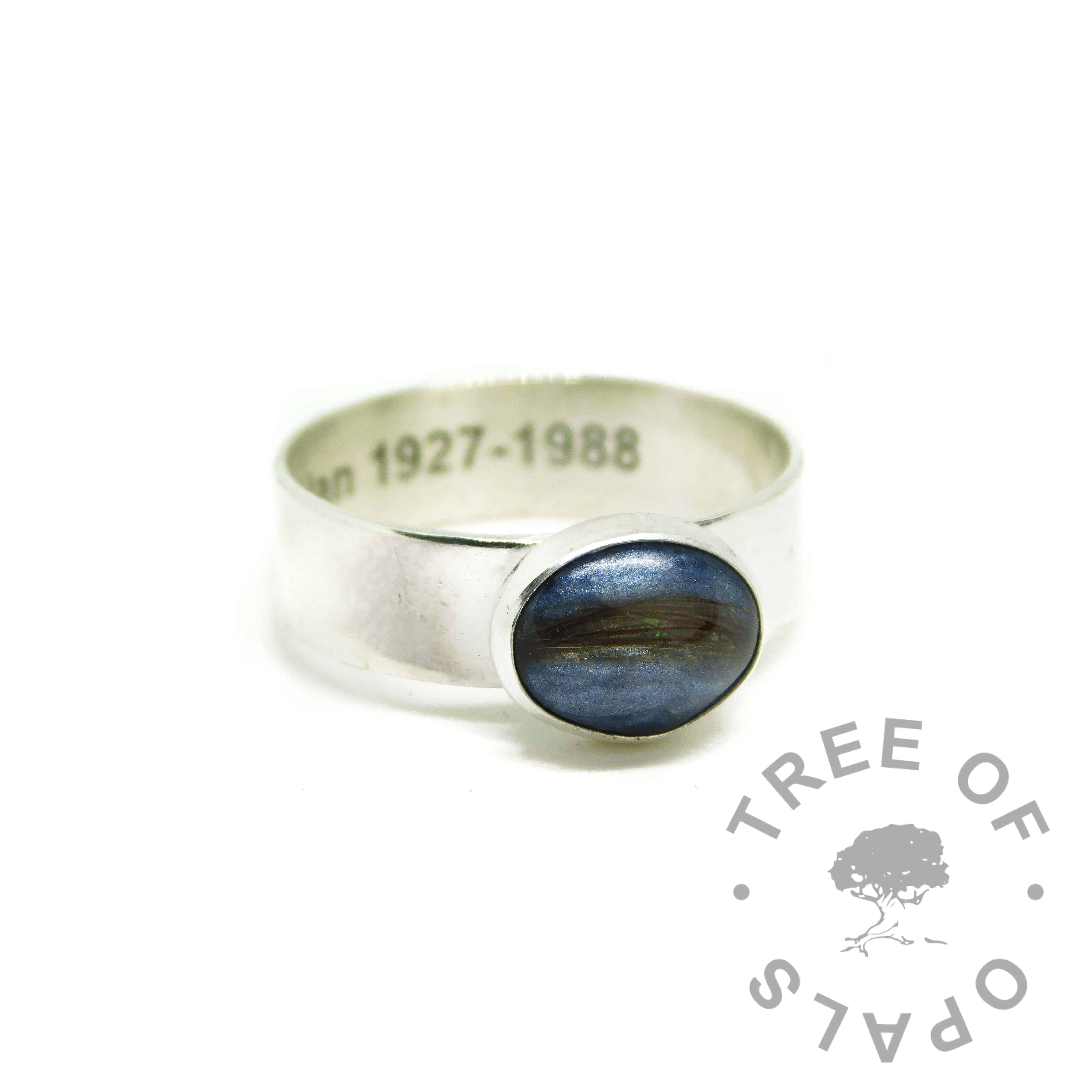 blue hair ring, lock of hair ring on 6mm shiny band with Arial font engraving on the inside. Aegean blue resin sparkle mix