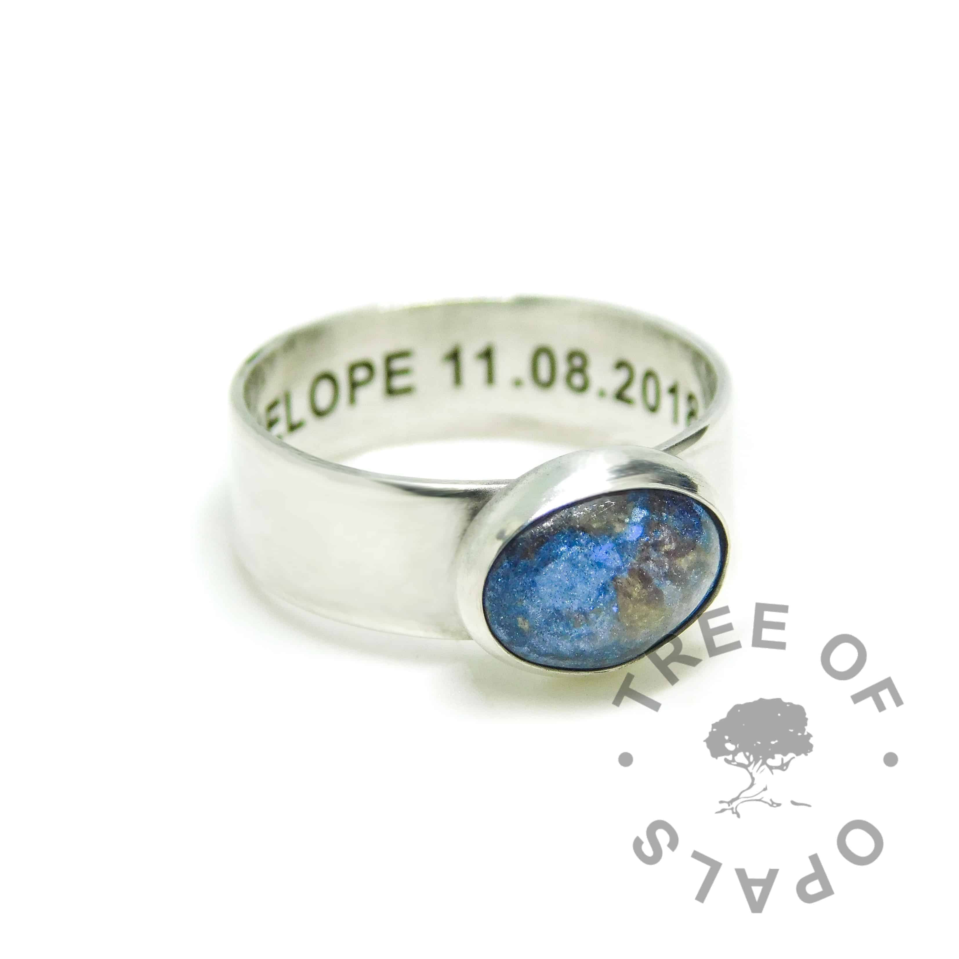 Aegean blue umbilical cord ring on 6mm shiny band. Solid 925 sterling EcoSilver handmade ring with engraved text on the inside of the band, in Arial font. 10x8mm bezel cup rubbed over the cabochon for security.