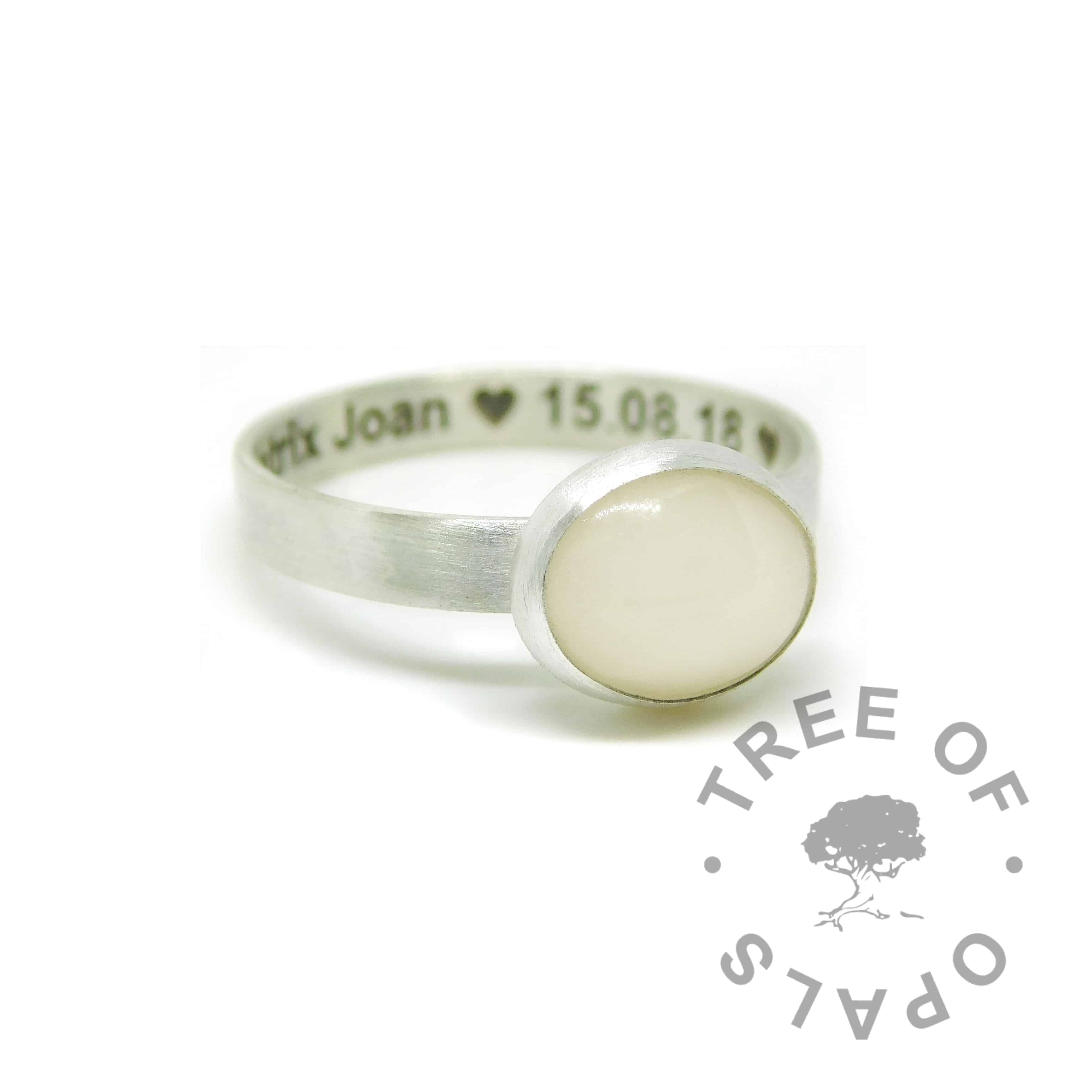 breastmilk ring with engraved text on the inside of the band with hearts, in Arial font. Solid sterling EcoSilver handmade ring. 10x8mm bezel cup rubbed over the cabochon for security.