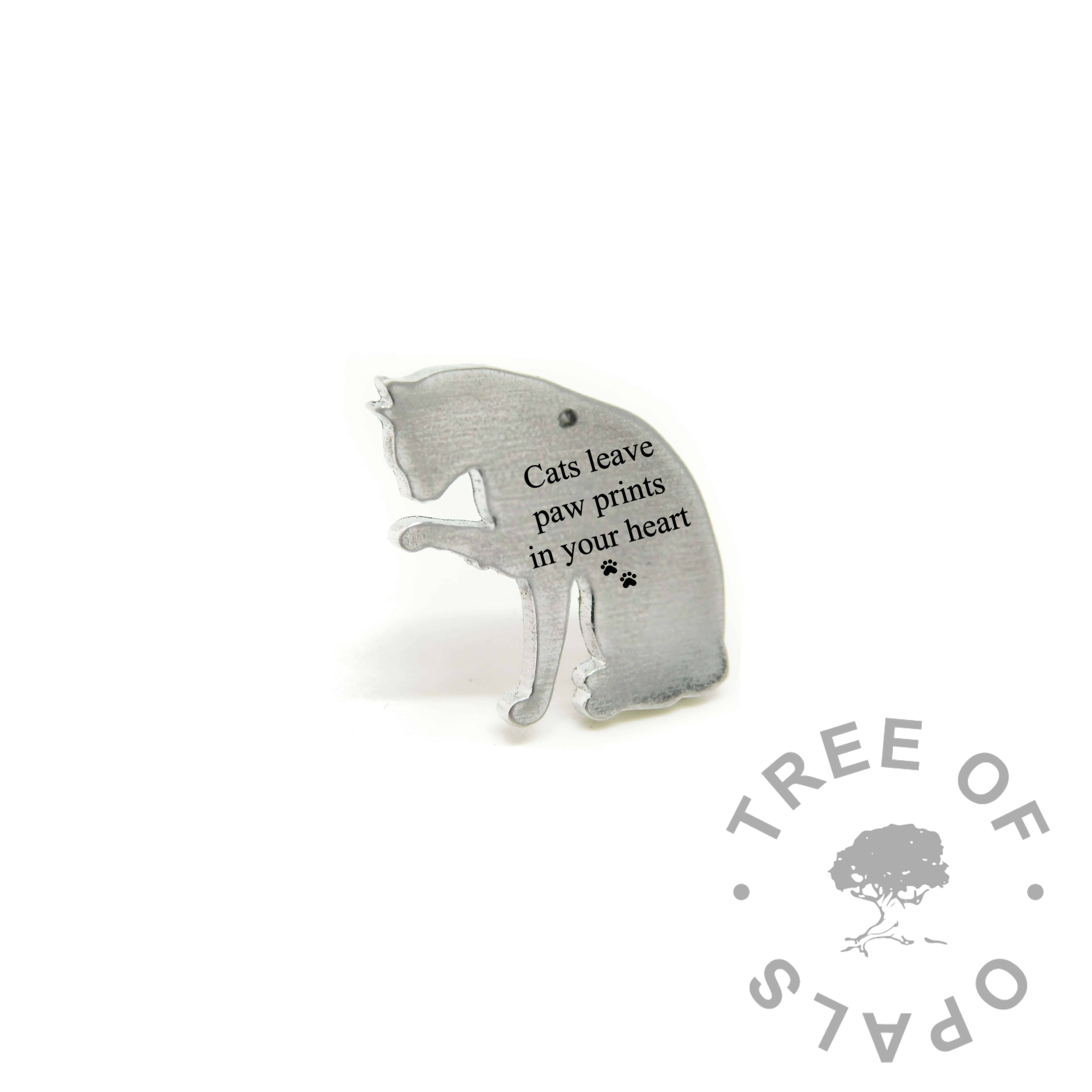 """cat necklace pendant engraved with """"Cats leave paw prints on your heart"""" and double paw print emoji. Engravable cat licking its paw shape, solid eco Argentium silver (mockup)"""