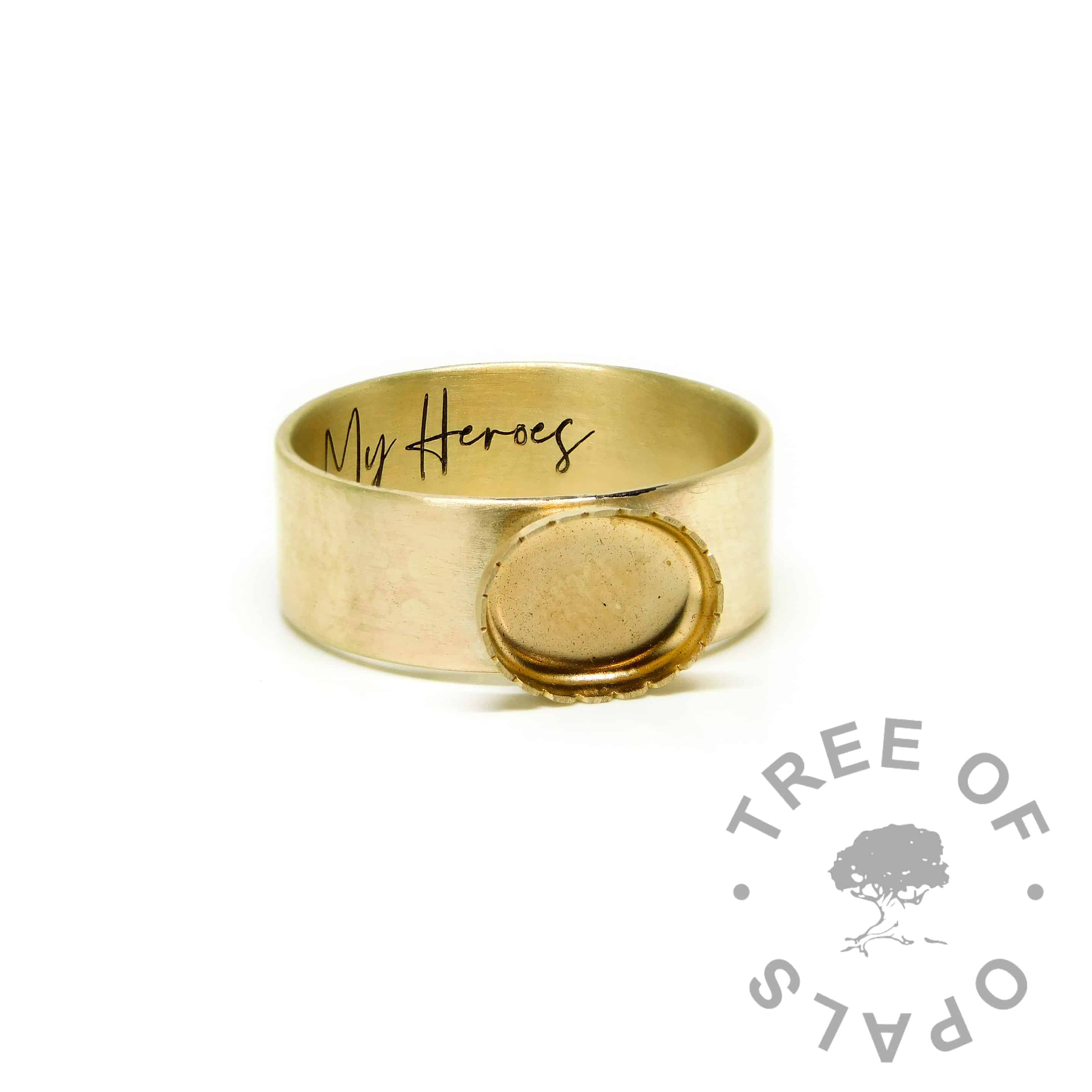 chunky gold ring engraved inside in Silver South Script font. Brushed band in 6mm width. The serrated points have been partially filed away which means less protection for the stone - we do not advise this!