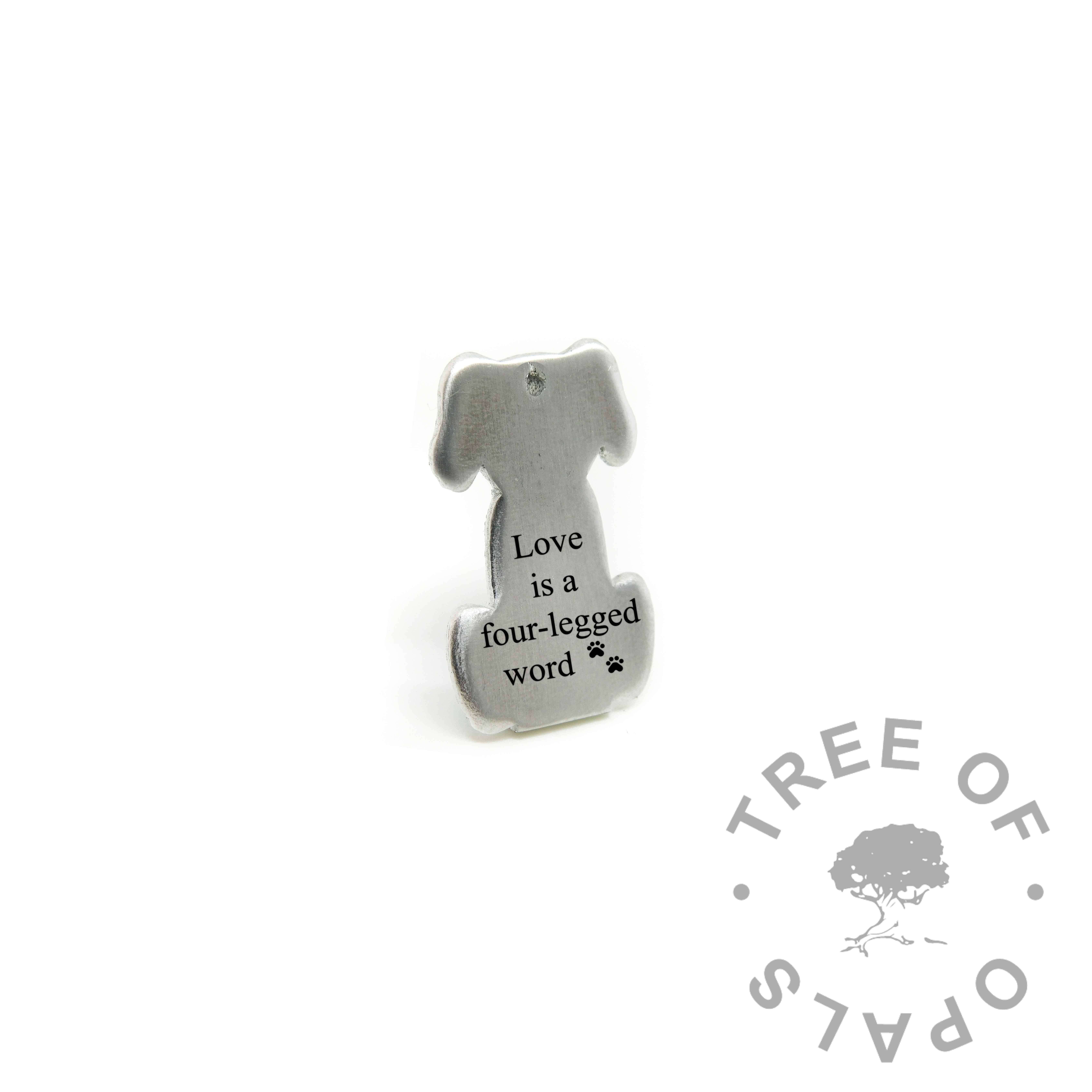 "dog necklace pendant engraved with ""Love is a four-legged word"" and double paw print emoji. Engravable cat licking its paw shape, solid eco Argentium silver (mockup)"