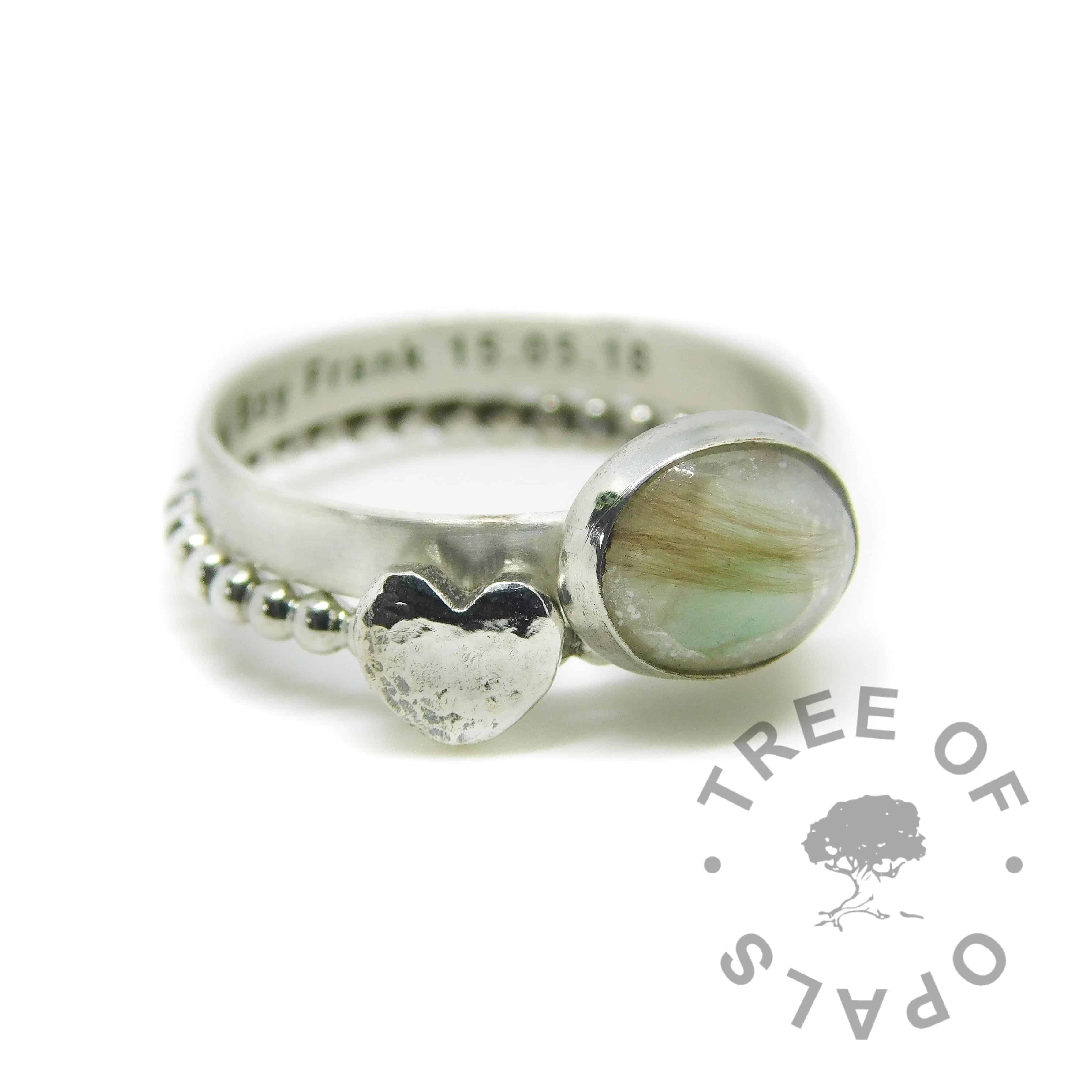 engraved lock of hair ring with peridot and unicorn white sparkles and bubble wire and textured heart accent stacker