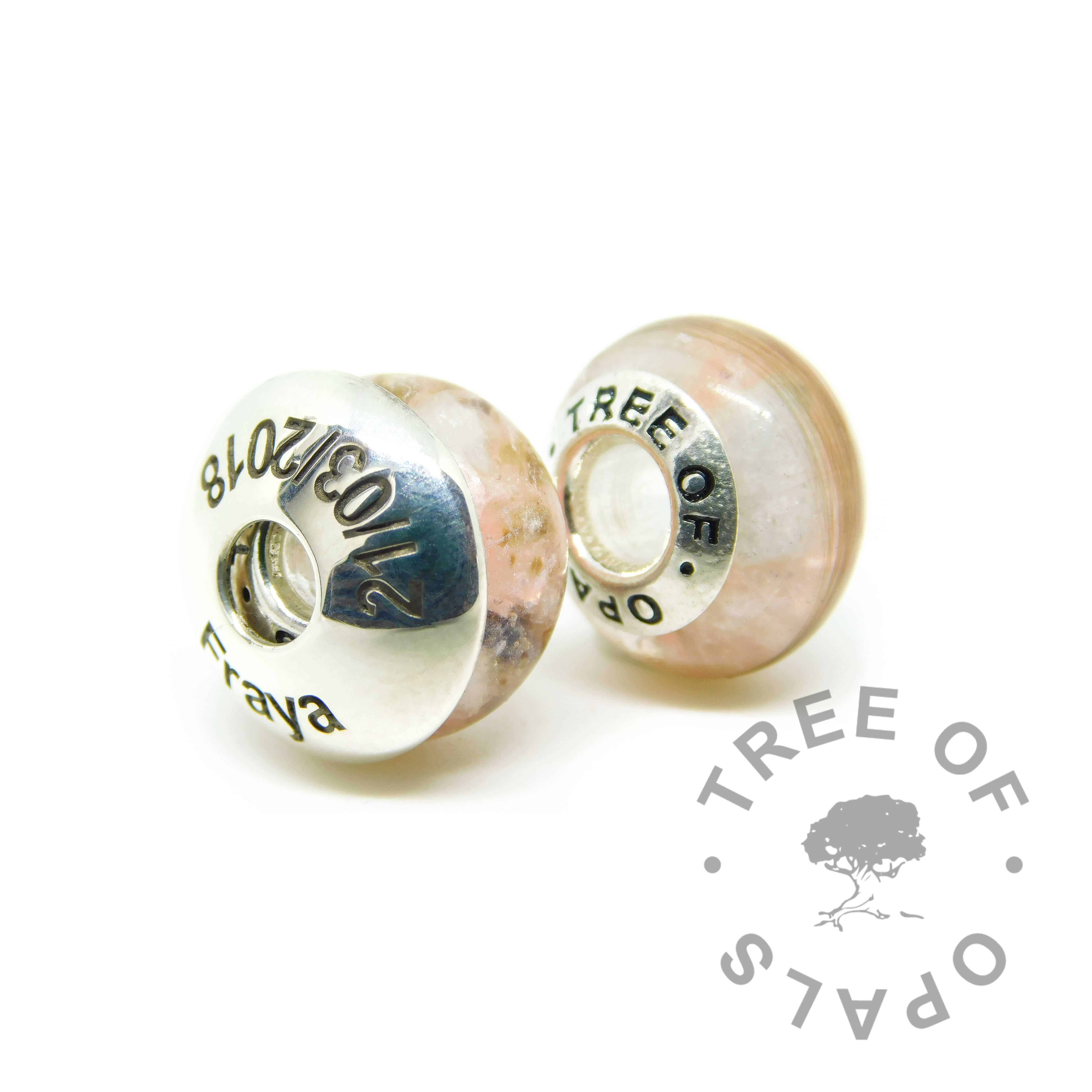 Umbilical cord and first curl charm duo. Both with fairy pink resin sparkle mix, March birthstone aquamarine. Set with solid sterling silver Tree of Opals core for Chamilia and Pandora bracelets. Watermarked copyright image by Tree of Opals
