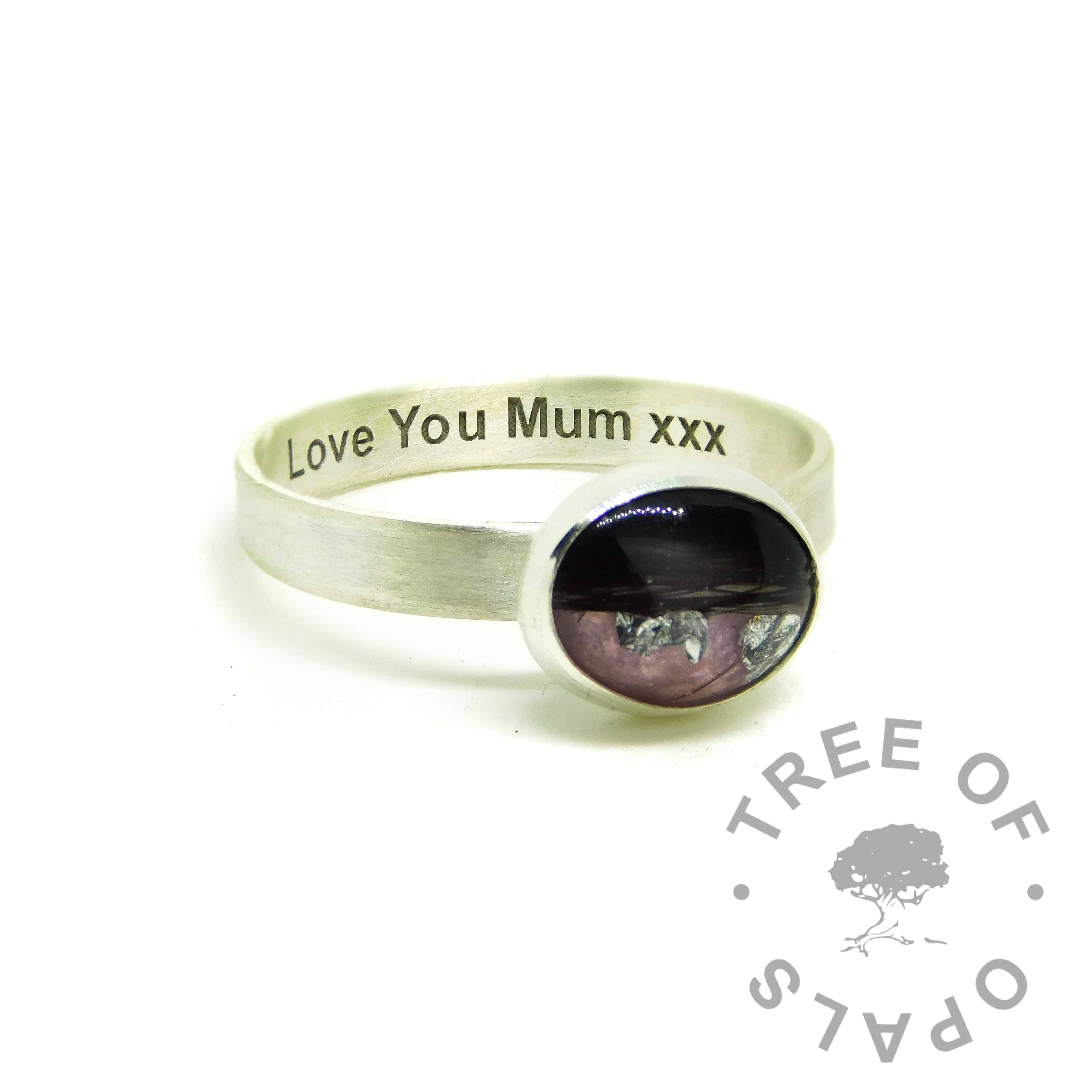 pink hair ring, lock of hair ring on brushed band with Arial font engraving on the inside. Fairy pink resin sparkle mix with silver precious metal leaf add-on