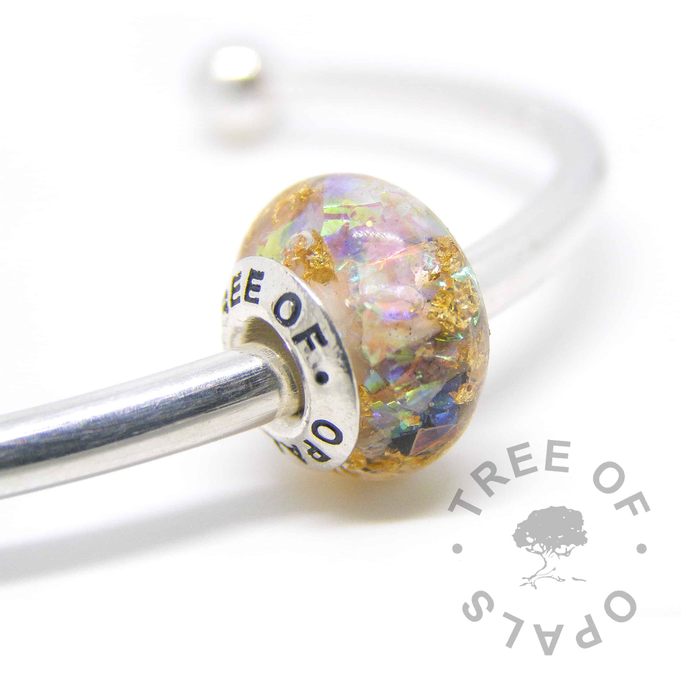 cremation ashes bead in resin, white opalescent, moonstone June birthstone and genuine gold leaf with a solid sterling silver Tree of Opals branded core cremation ash charm