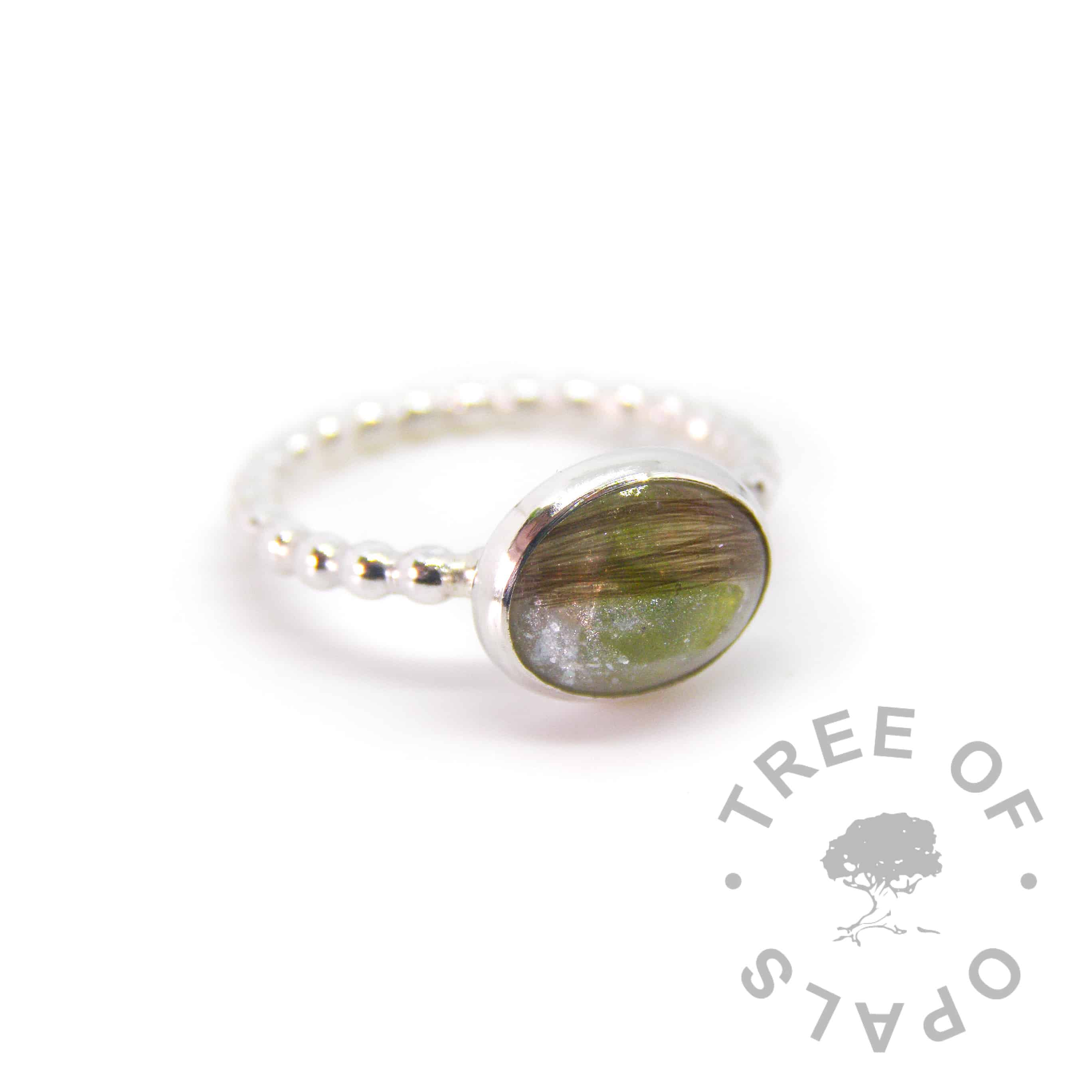 lock of hair ring with peridot August birthstone, unicorn white sparkle mix on a bubble wire band, handmade by Tree of Opals in solid sterling silver