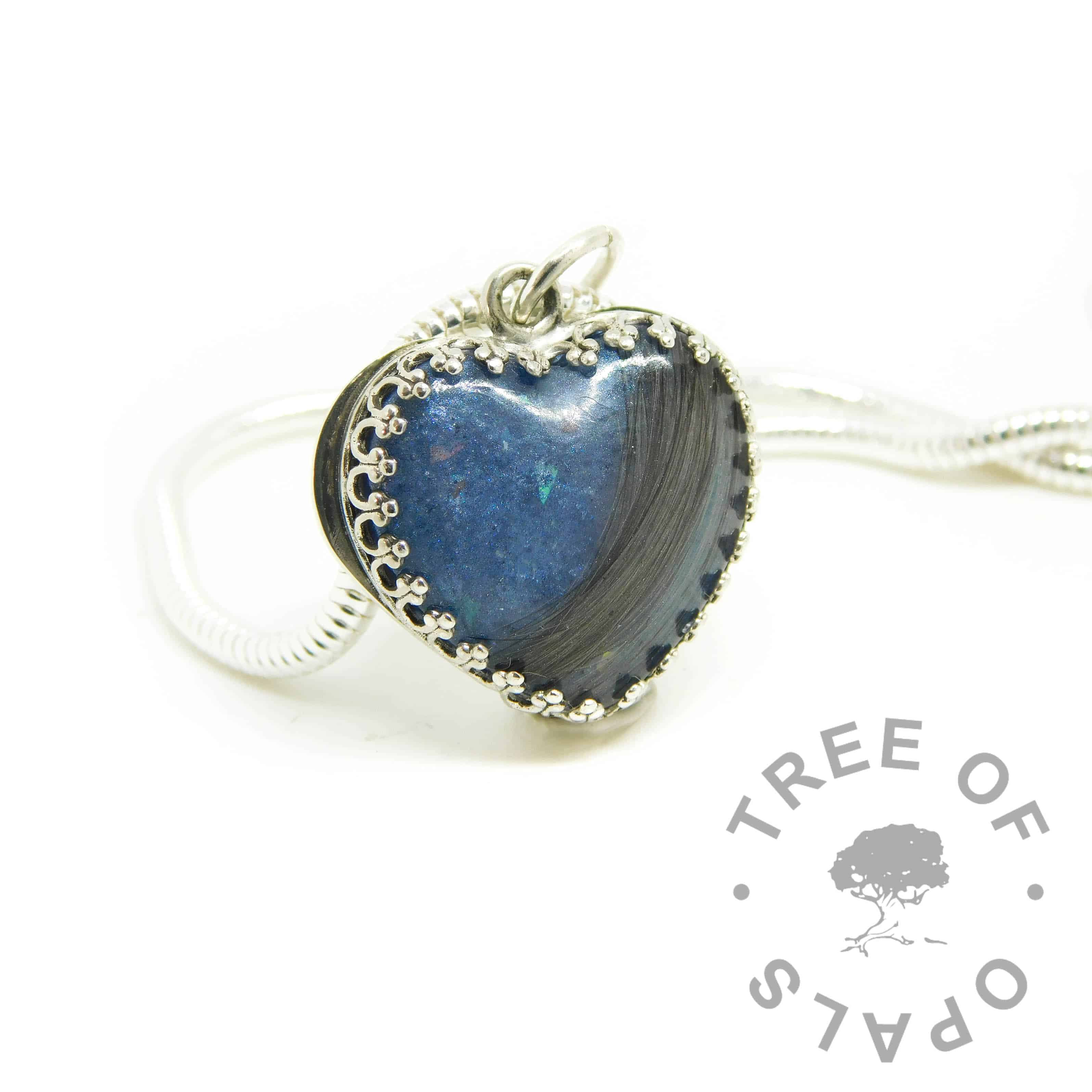 blue hair heart with brown hair with some grey strands. Aegean blue resin sparkle mix